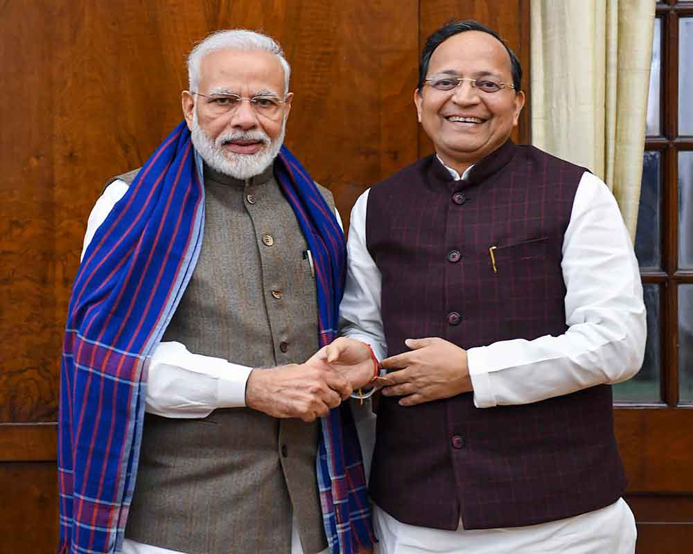 Prime Minister Narendra Modi shakes hands with BJP leader Arun Singh who recently took oath as Rajya Sabha member, during a meeting - PTI