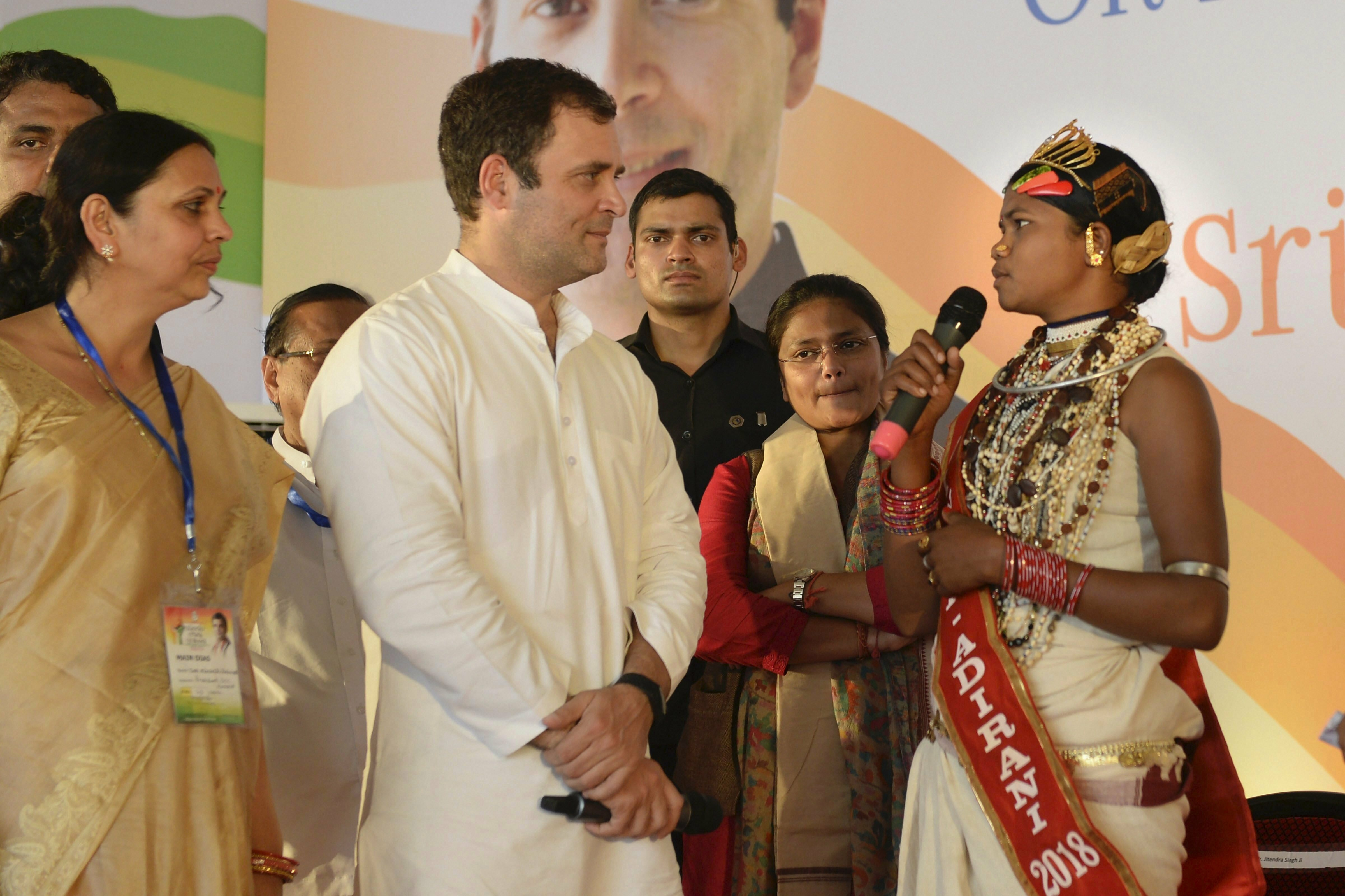 Congress President Rahul Gandhi interacts with a villager at a public meeting in Jeypore area of Koraput - PTI