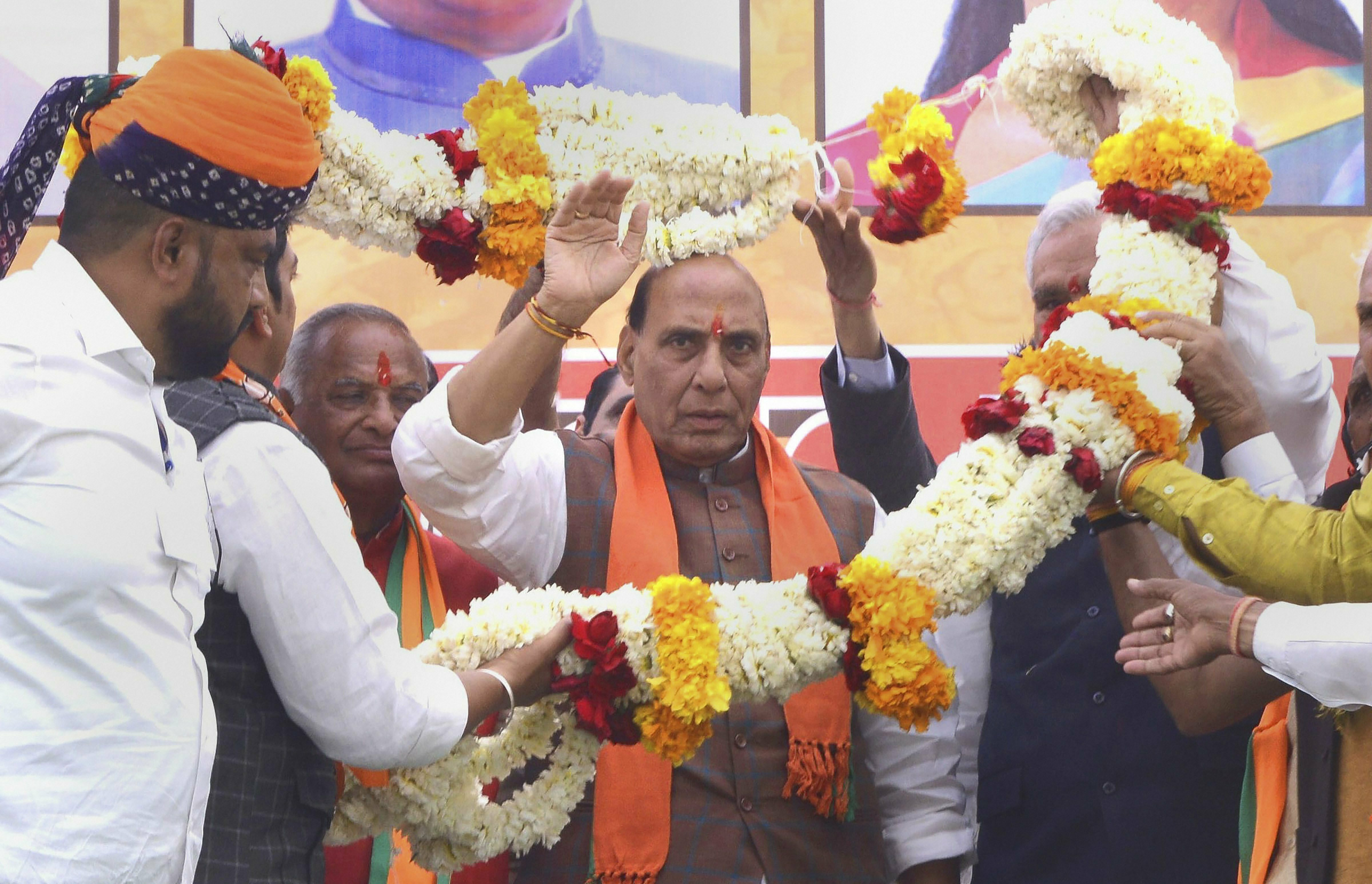 Union Home Minister Rajnath Singh being garlanded at a public meeting, in Beawar - PTI