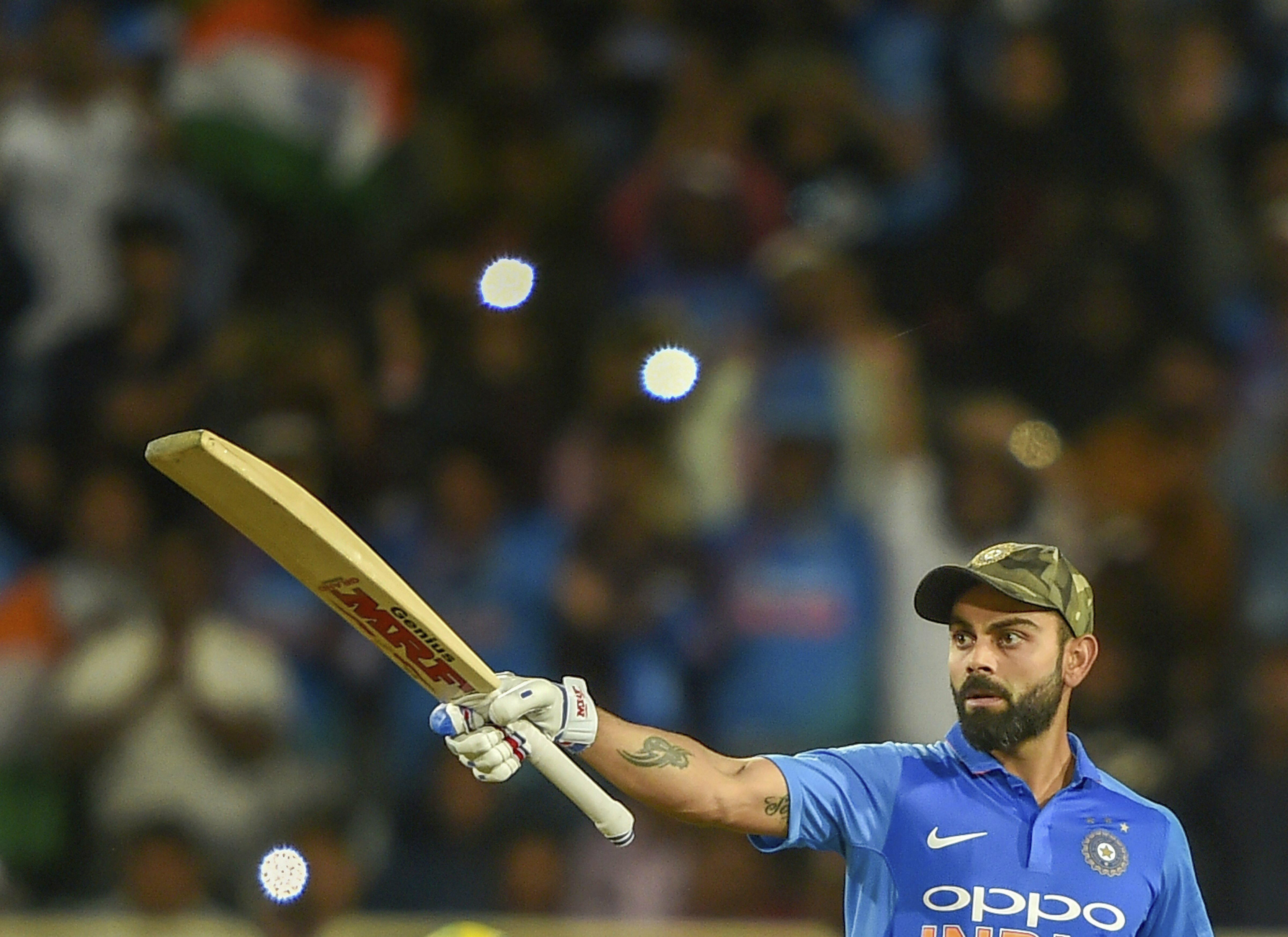 Indian skipper Virat Kohli acknowledges the crowd after hitting a century during the 3rd ODI cricket match against Australia, in Ranchi - AP