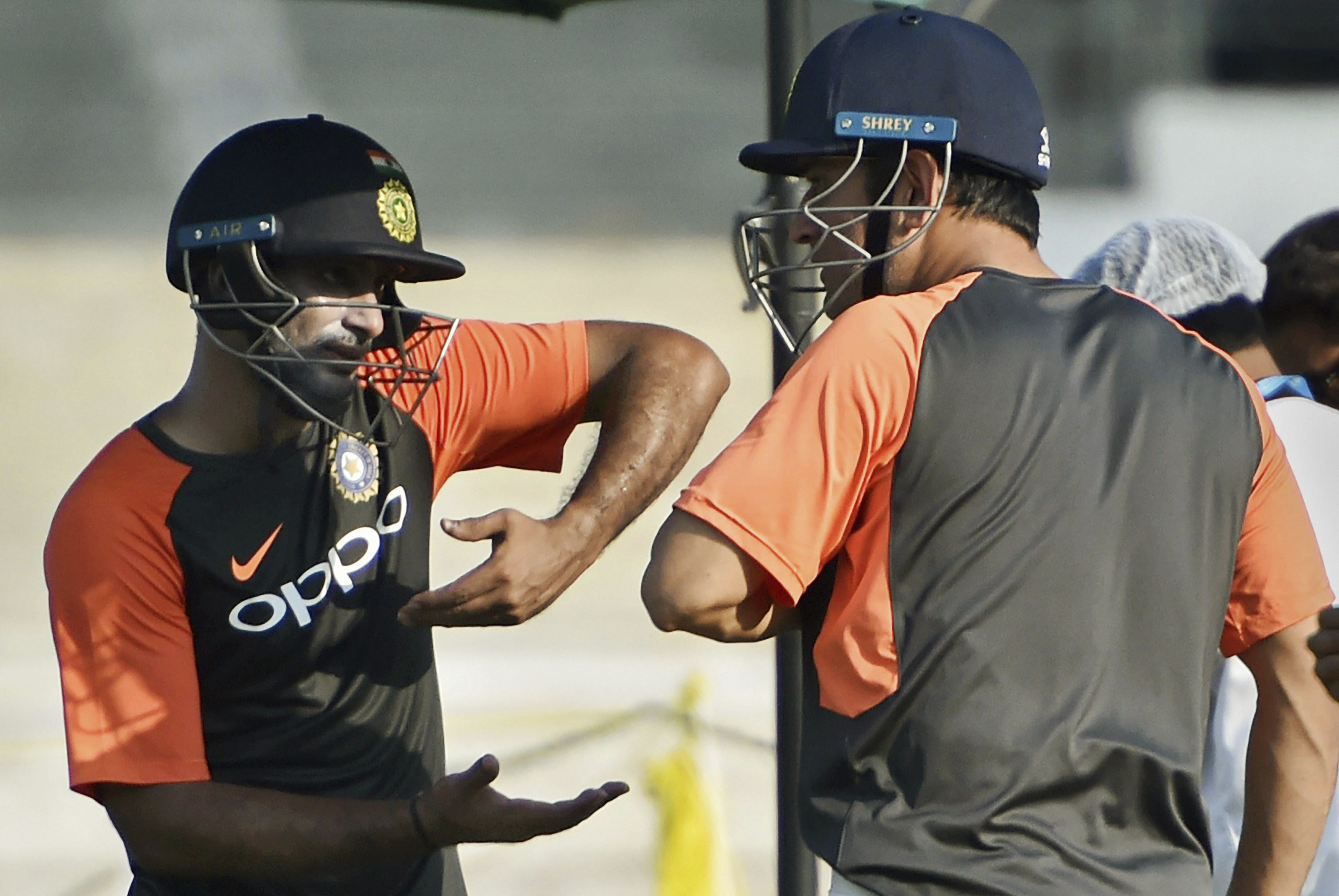 Team India players Ambati Rayudu and MS Dhoni during a practice session ahead of 4th ODI cricket match against West Indies, in Mumbai - PTI