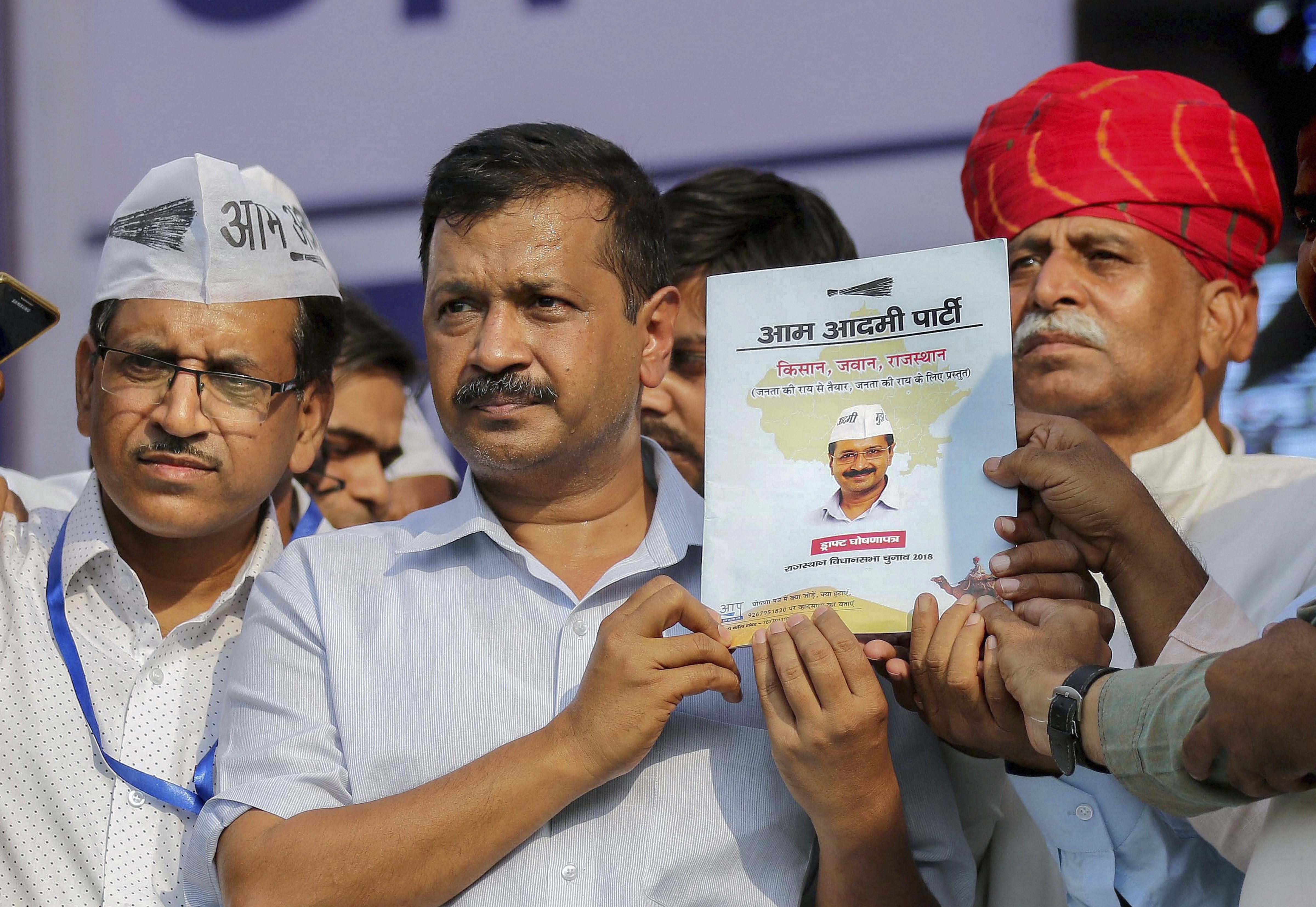 Delhi Chief Minister Arvind Kejriwal launches Aam Aadmi Party manifesto during a public meeting, at Ramlila Maidan in Jaipur  - PTI