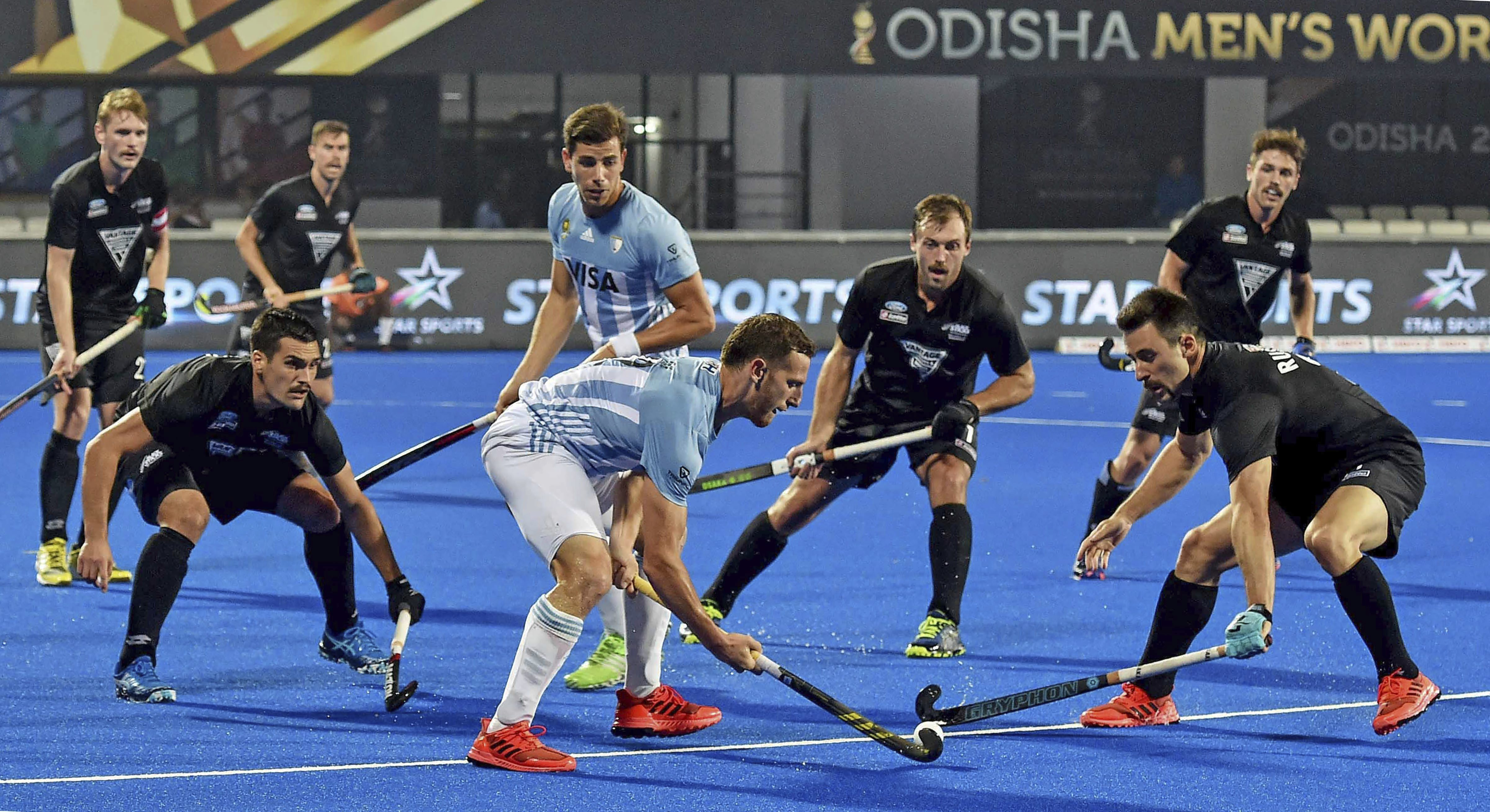Lucas Vila (in blue) of Argentina in action during a match against New Zealand at Men's Hockey World Cup 2018, in Bhubaneswar - PTI