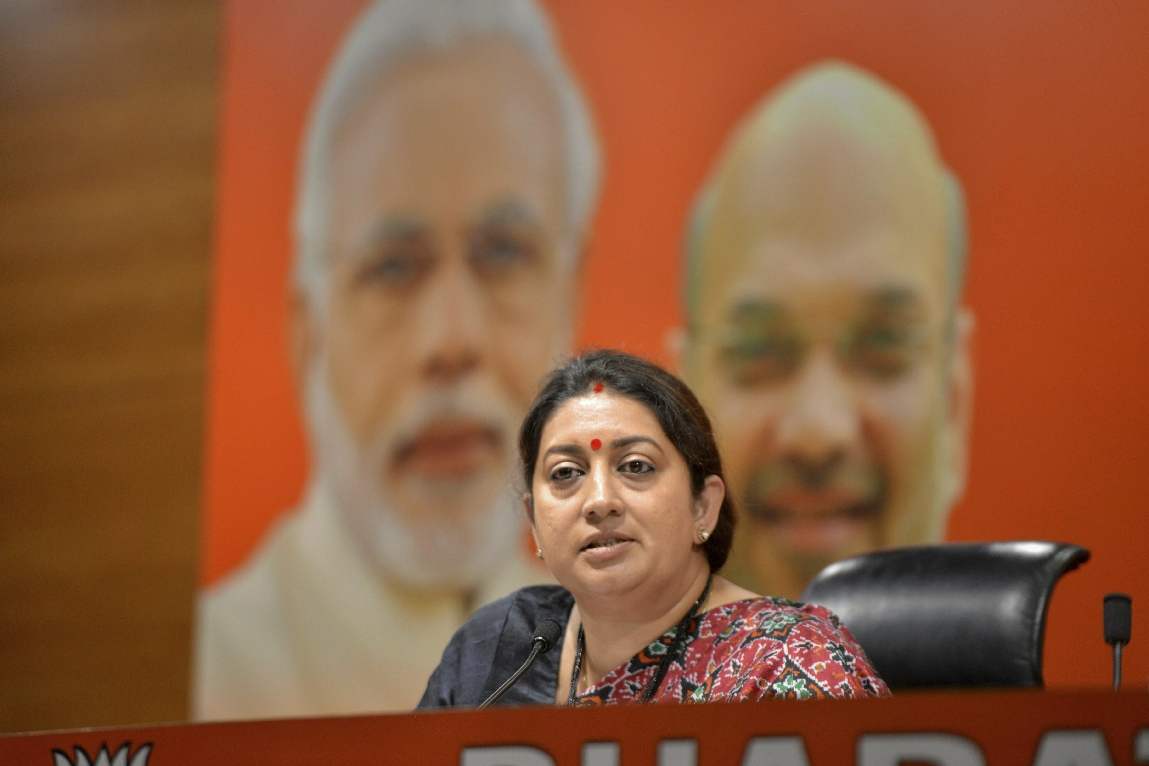 Union Minister Smriti Irani addresses a press conference, in New Delhi - PTI