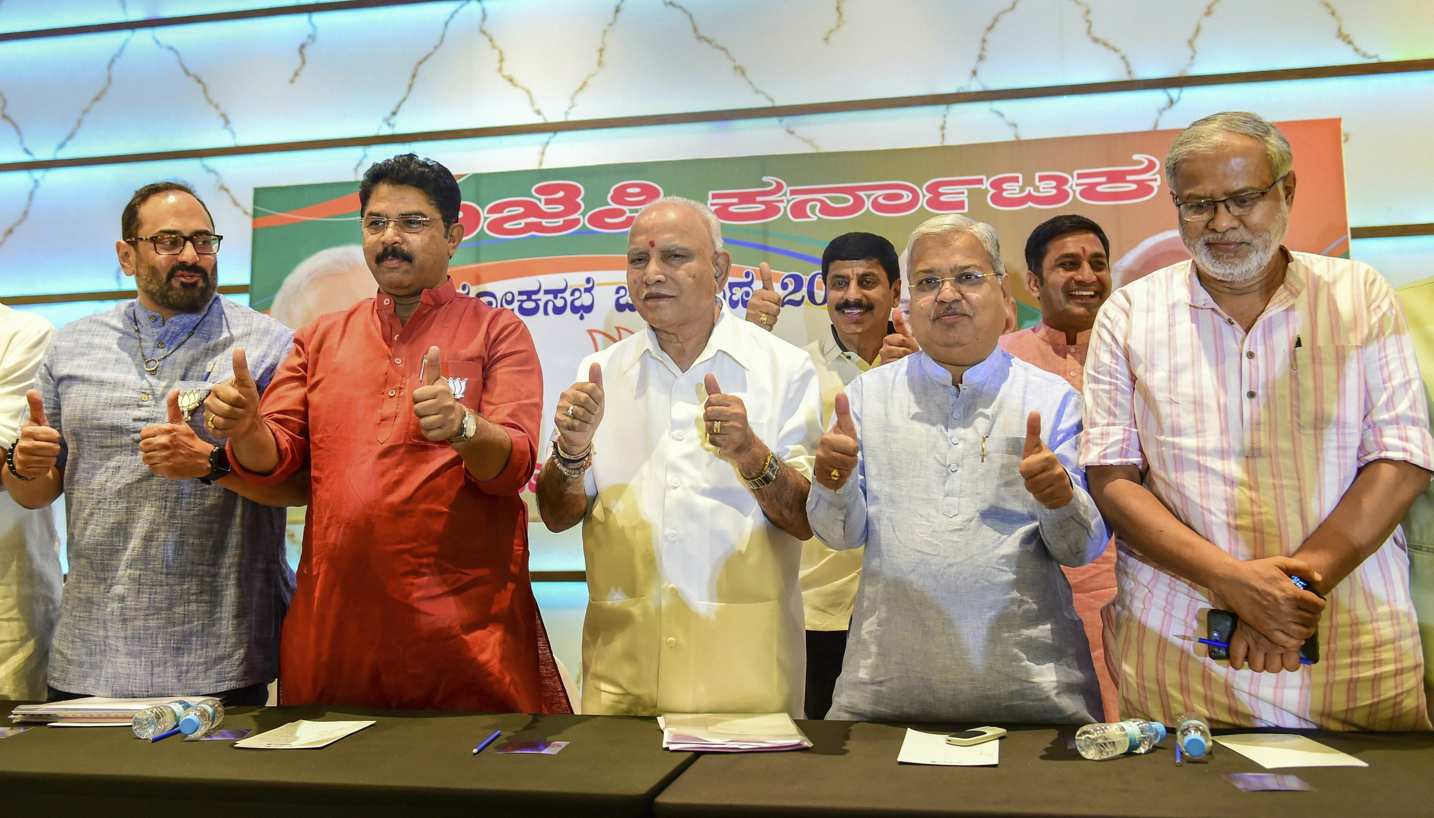 BJP Karnataka President BS Yediyurappa with state leaders pose for photos after addressing a press conference ahead of Lok Sabha elections 2019, in Bengaluru - AP