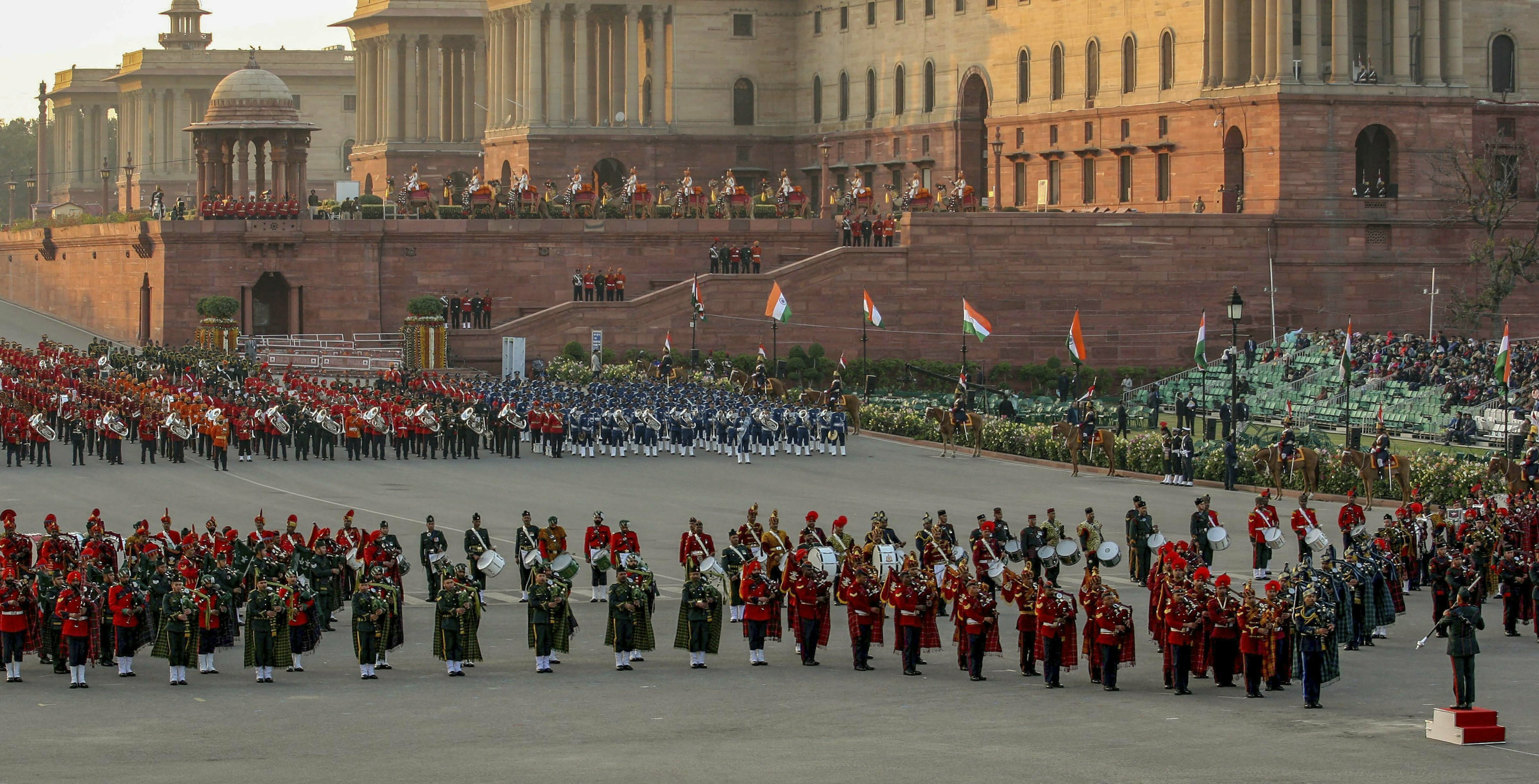 Tri-services bands perform during a rehearsal for the Beating Retreat ceremony at Vijay Chowk, in New Delhi - PTI