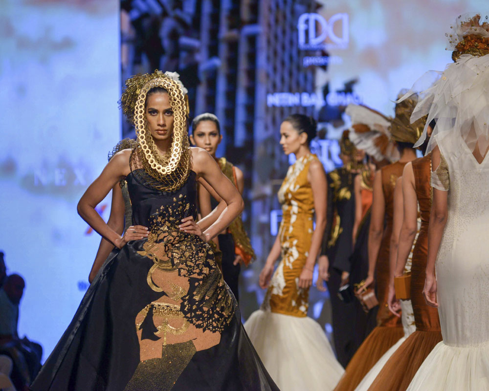 A model presents a creation by designer Nitin Bal Chauhan at India Fashion Week, in New Delhi - PTI