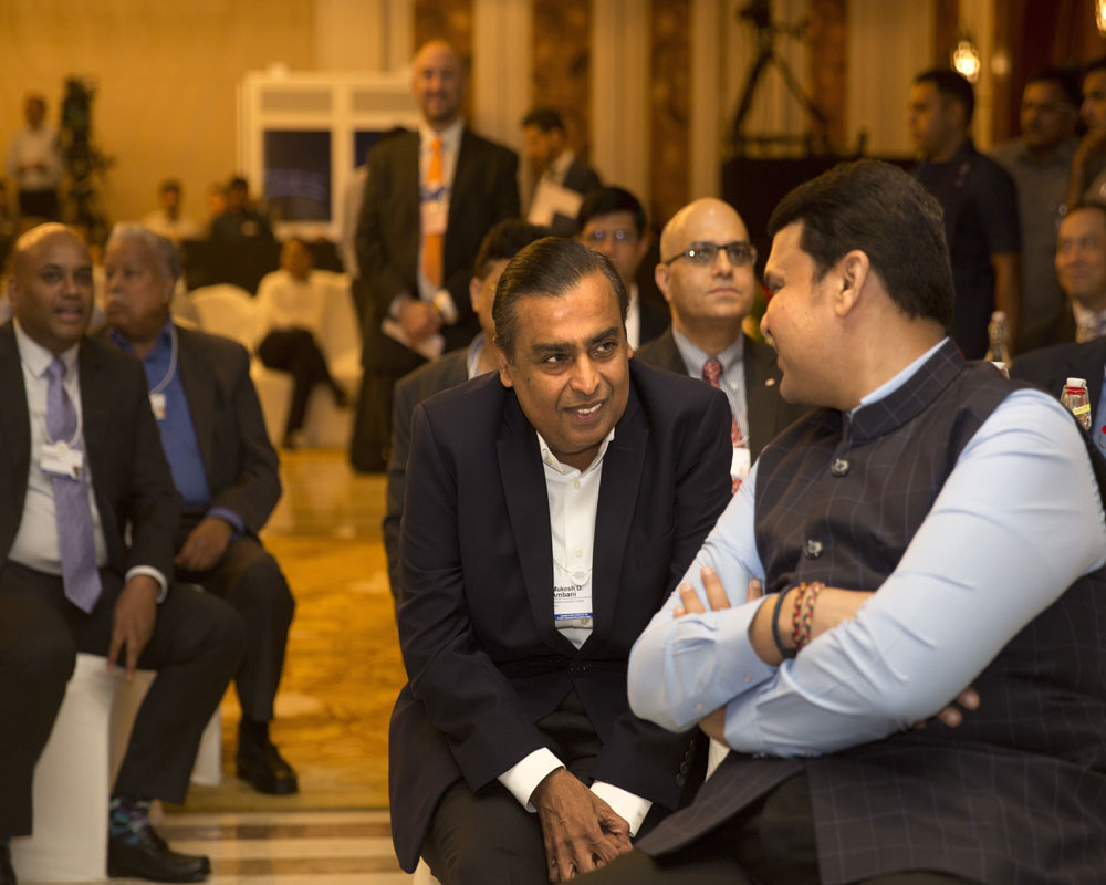 Chairman of Reliance Industries Mukesh Ambani, center, speaks with Chief Minister of Maharashtra state Devendra Fadnavis, right, at the launch of Centre for the Fourth Industrial Revolution India in New Delhi - AP