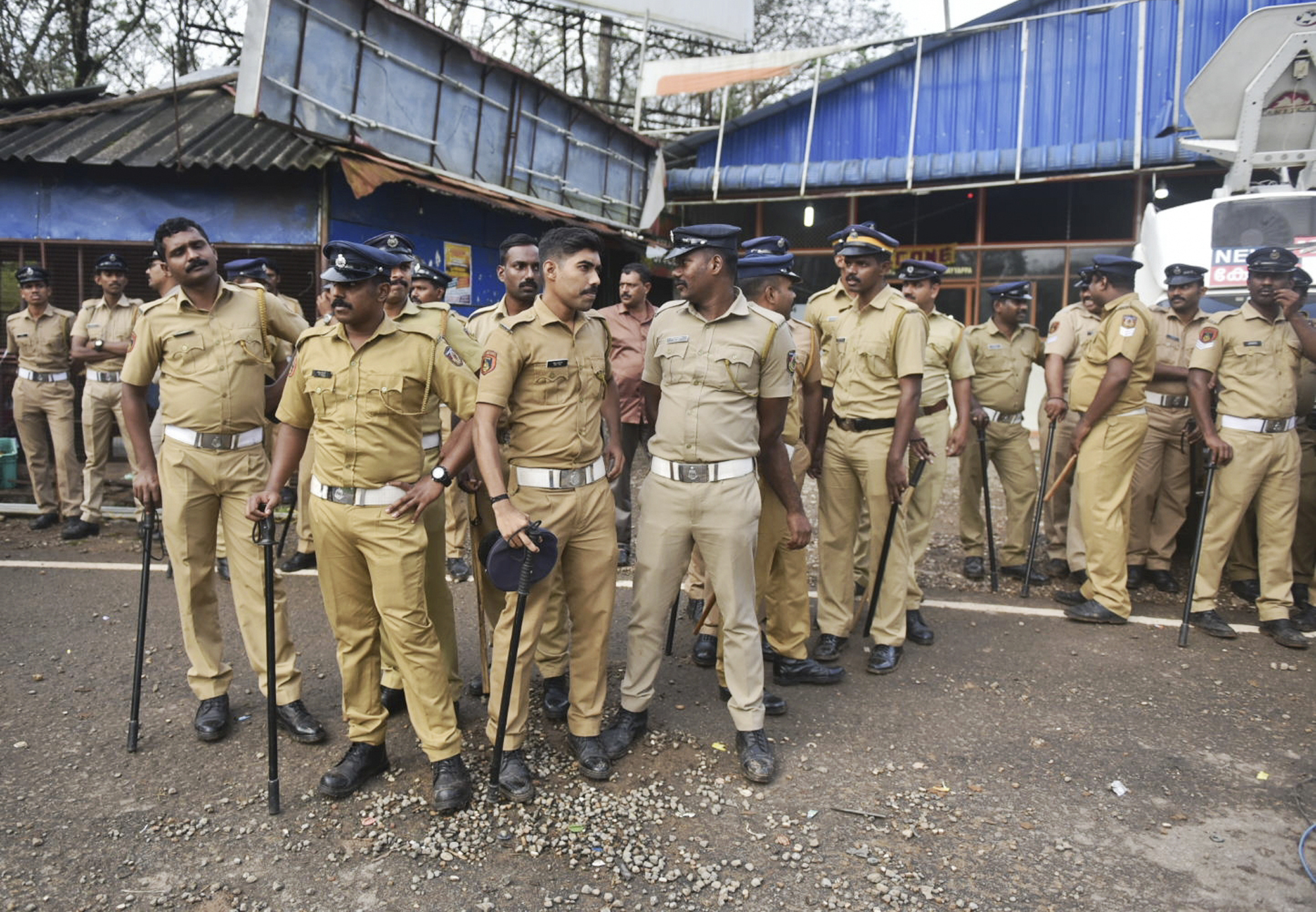 ndian policemen are deployed to guard against protestors who are opposed to allowing women of menstruating age from entering the Sabarimala temple at Nilackal, a base camp on way to the mountain shrine in Kerala - AP