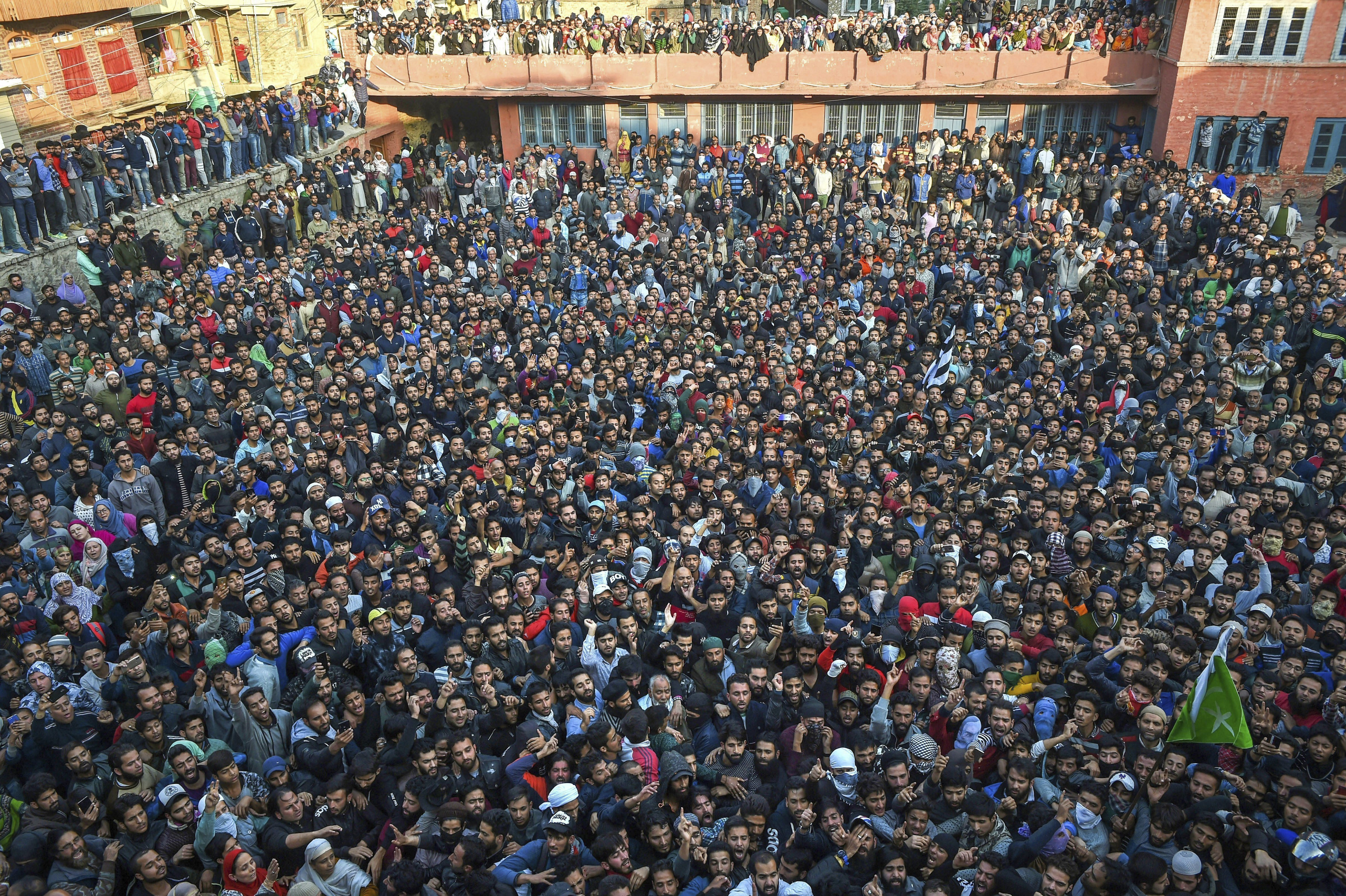 People attend the funeral procession of top Lashkar-e-Toiba (LET) commander Mehrauddin Bangroo and his associate, who were killed in an encounter at Fateh Kadal, in Srinagar - PTI