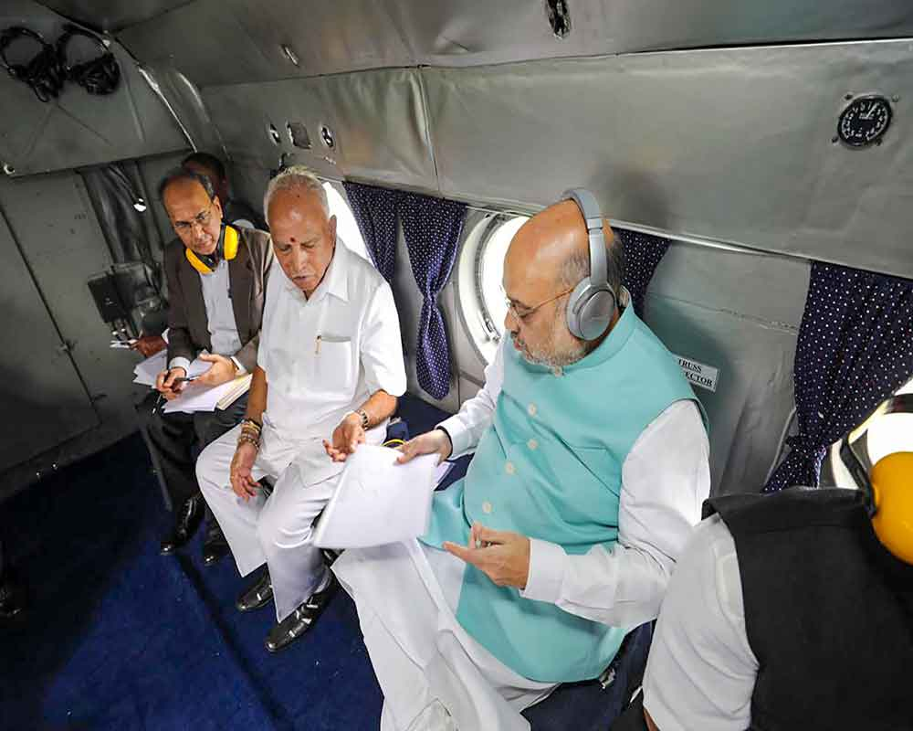 Union Home Minister Amit Shah and Karnataka Chief Minister BS Yeddiurappa undertake aerial survey to review the food situation in Belagavi district - PTI
