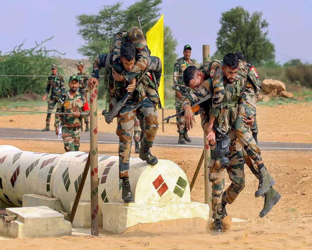 Army personnel take part in stage III of the International Army Scout Masters Competition at The Scouts Trail in Jaisalmer Military Station - PTI