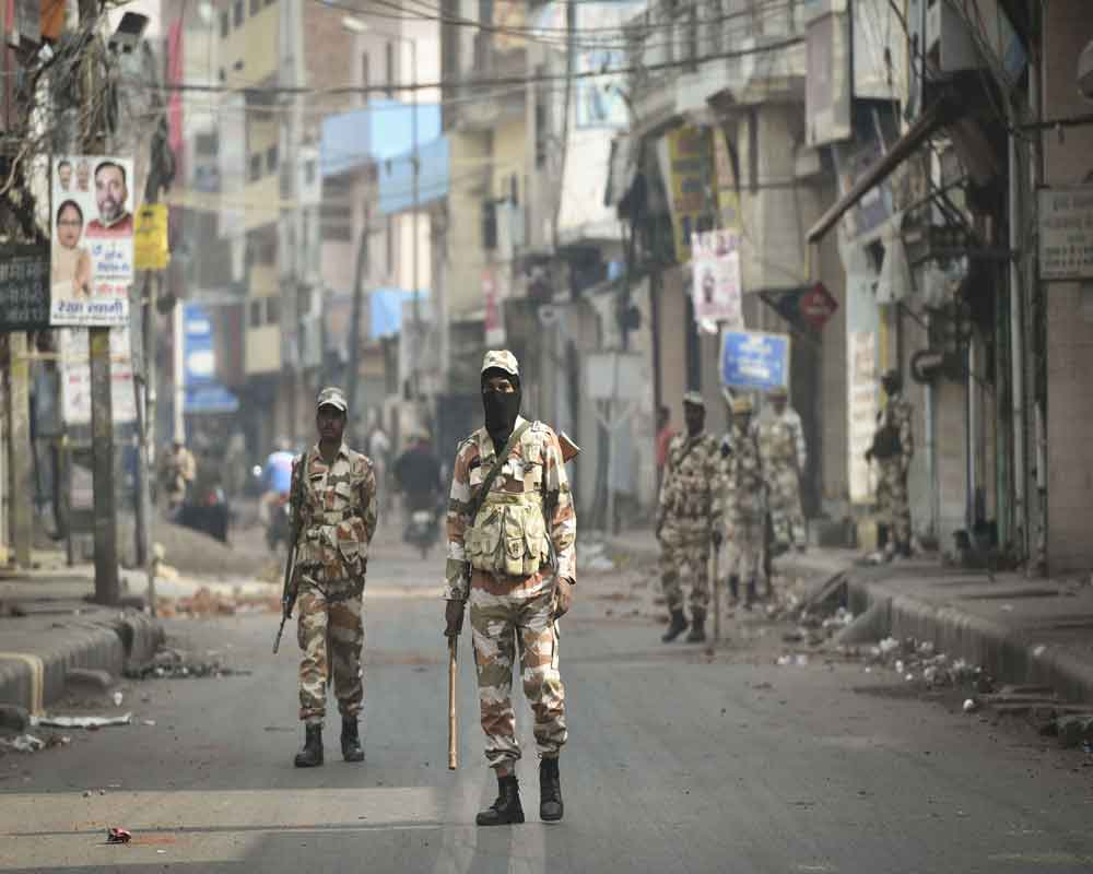 Security personnel patrol streets following clashes over the new citizenship law, in Yamuna Vihar area of northeast Delhi - PTI