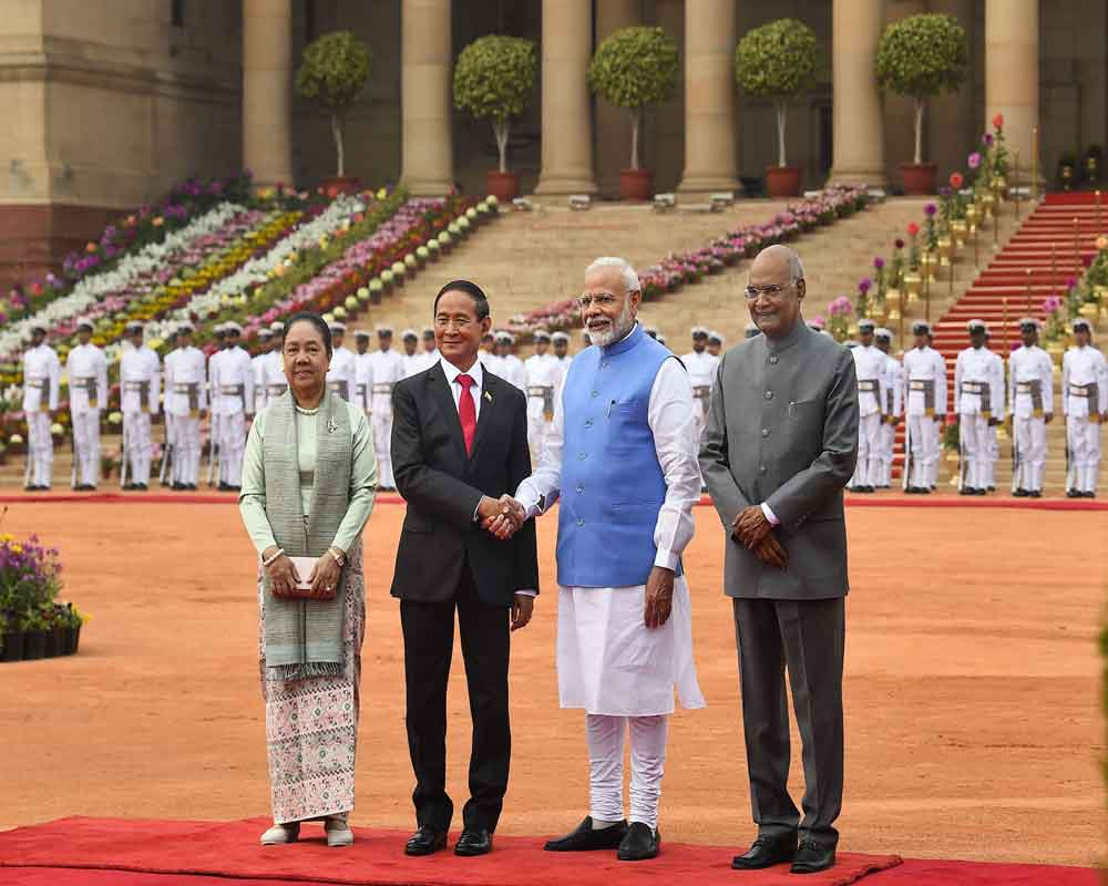 Prime Minister Narendra Modi (2R) shakes hands with Myanmar President U Win Myint (2L) as President Ram Nath Kovind (R) and Myanmar's First Lady Daw Cho Cho look on, during a ceremonial reception at Rashtrapati Bhavan, in New Delhi - PTI
