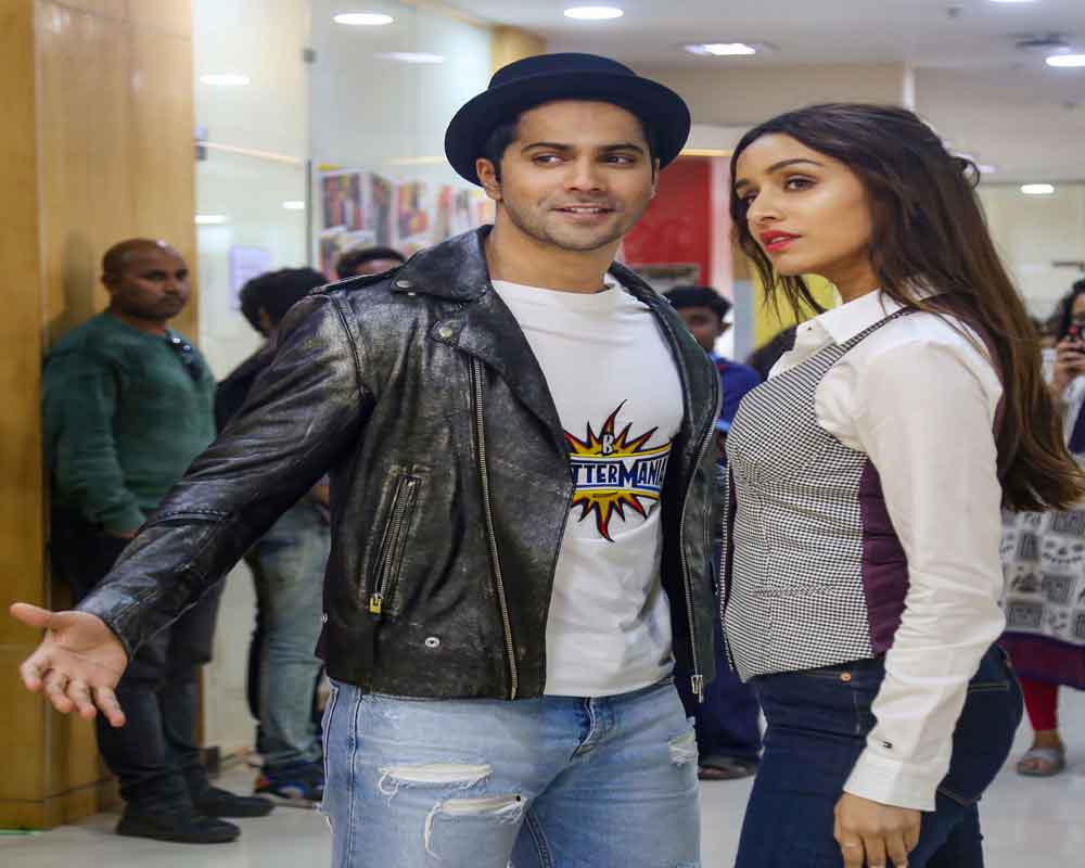 Bollywood actor Varun Dhawan and Shraddha Kapoor pose for photographs during promotion of their upcoming movie  'Street Dancer 3D' in Mumbai - PTI