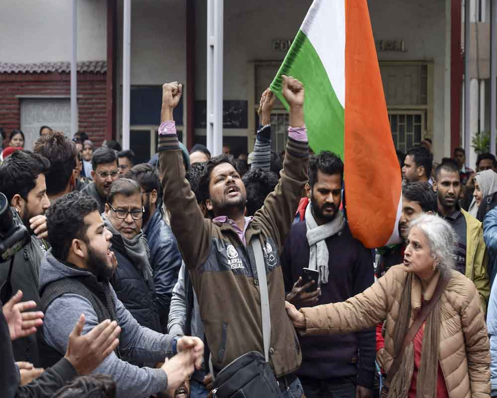 Jamia Milia Islamia University students during a protest against their Vice Chancellor (VC) Najma Akhtar, demanding registration of an FIR against Delhi Police in connection with last month's violence inside the campus, in New Delhi - PTI