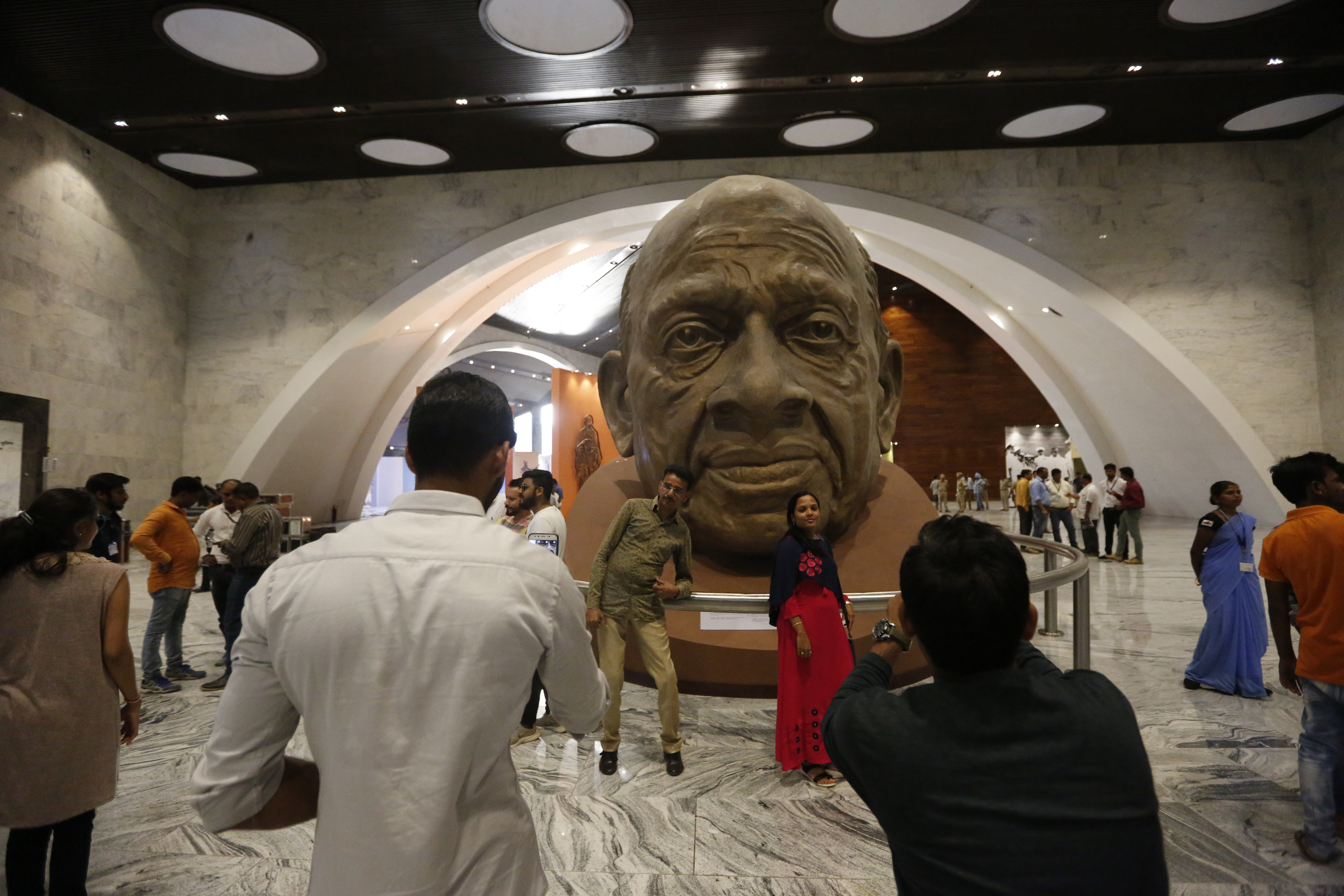 Visitors takes photograph with a sculpture of Sardar Patel inside an exhibition hall at the base of Statue of Unity at Kevadiya Colony in Narmada district of Gujarat State - AP