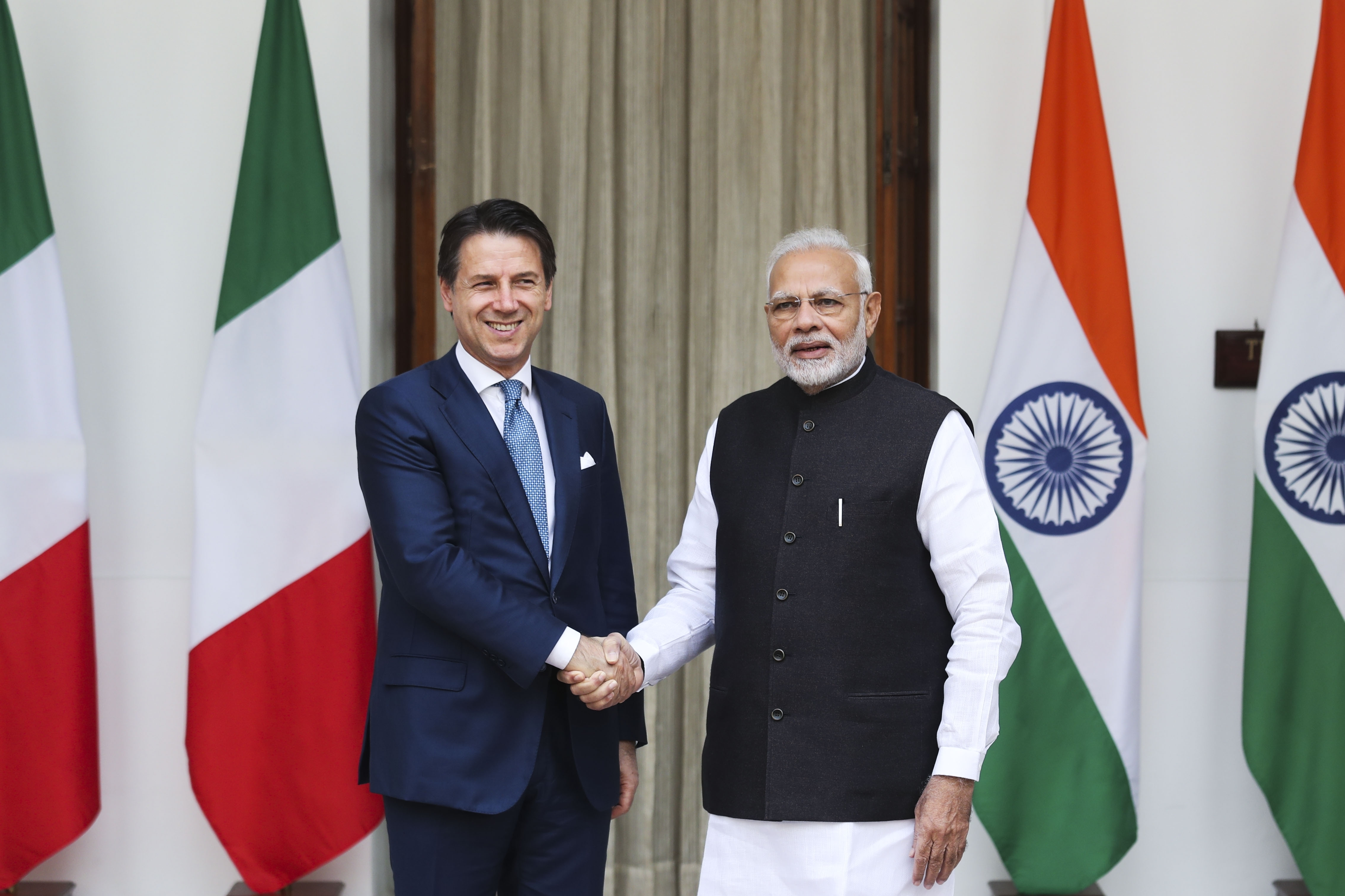 Indian Prime Minister Narendra Modi, right, shakes hands with Italian Prime Minister Giuseppe Conte before their meeting in New Delhi - AP