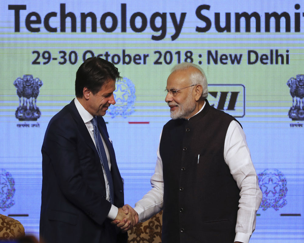 Indian Prime Minister Narendra Modi, right, shakes hands with Italian Prime Minister Giuseppe Conte after later's speech at the India Italy Technology summit in New Delhi - AP