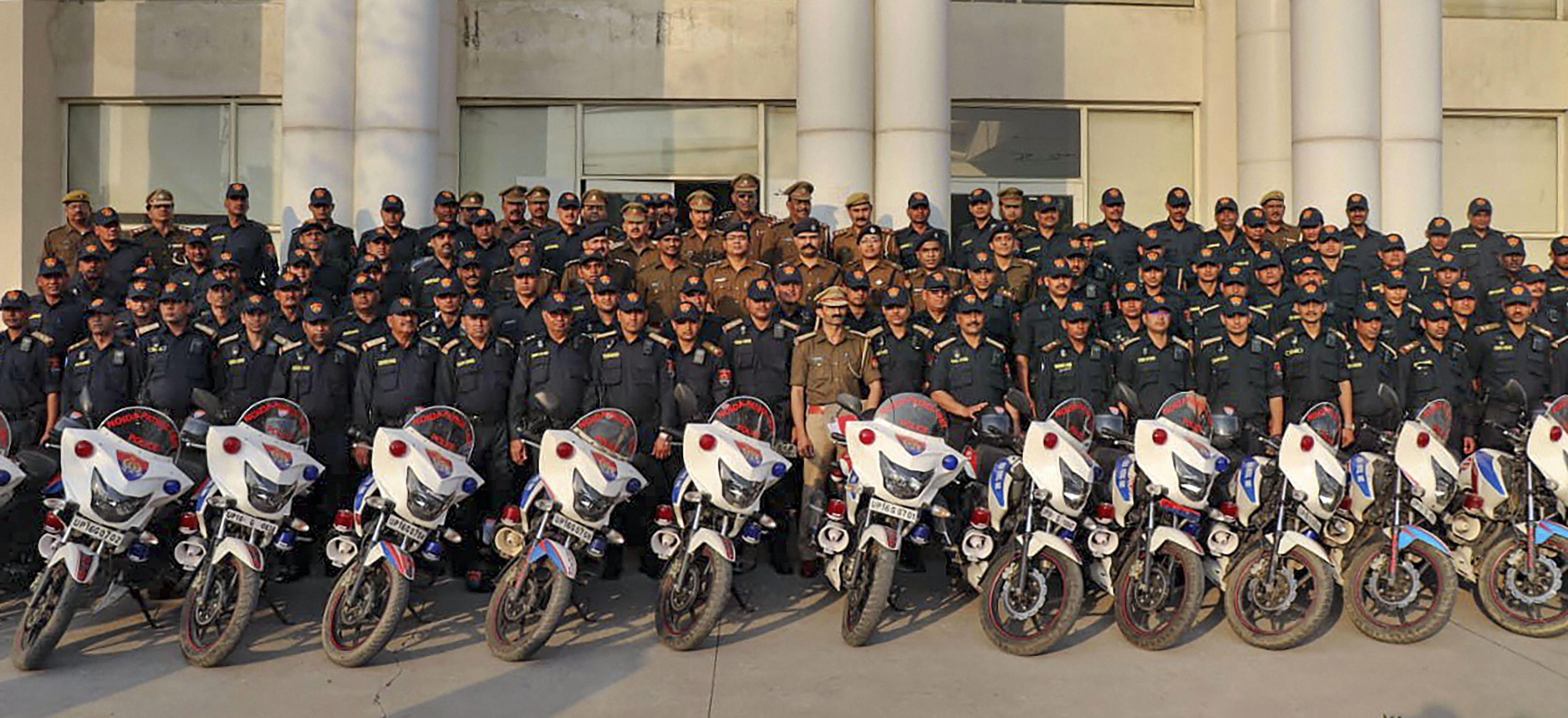 Special bike-borne Noida Patrol Unit (NPU) members pose with their bikes during its launch, in Noida - PTI