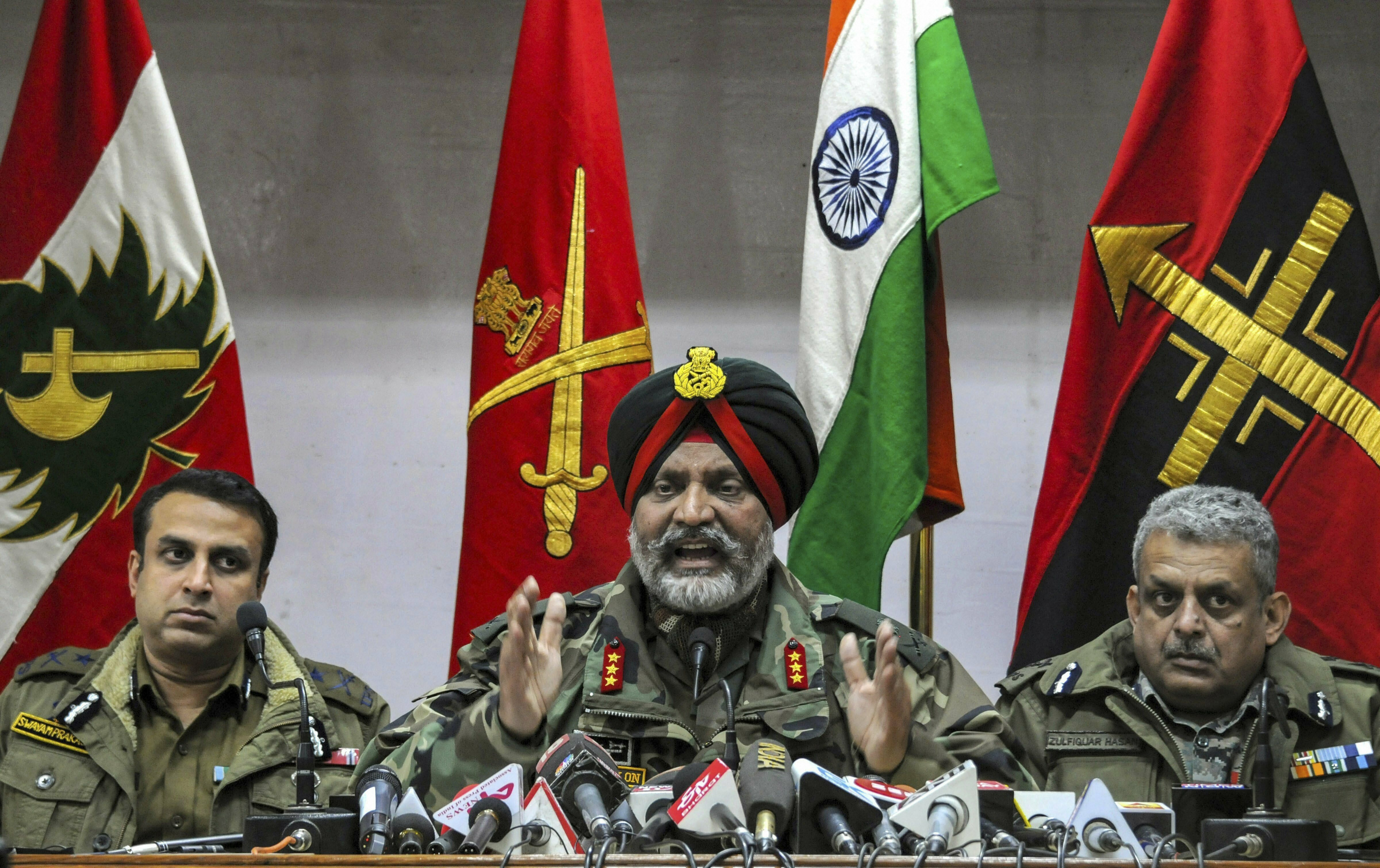 Indian Army's Lt General KJS Dhillon, Inspector General of Police Kashmir S P Pani (L) and CRPF Inspector General Kashmir Zulfiqar Hassan (R) address a joint press conference at Army's 15 Corps headquarters, Badami Bagh in Srinagar - PTI