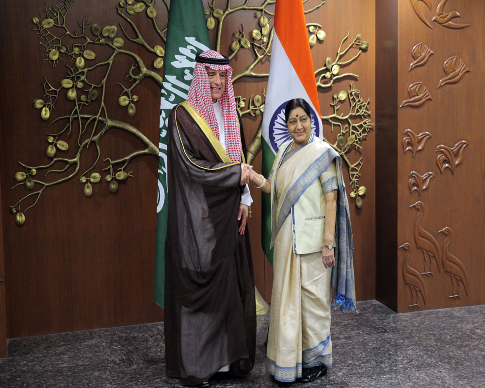 Indian Foreign Minister Sushma Swaraj, right, shakes hand with her Saudi Arabia counterpart Adel al-Jubeir before their delegation level meeting in New Delhi - AP