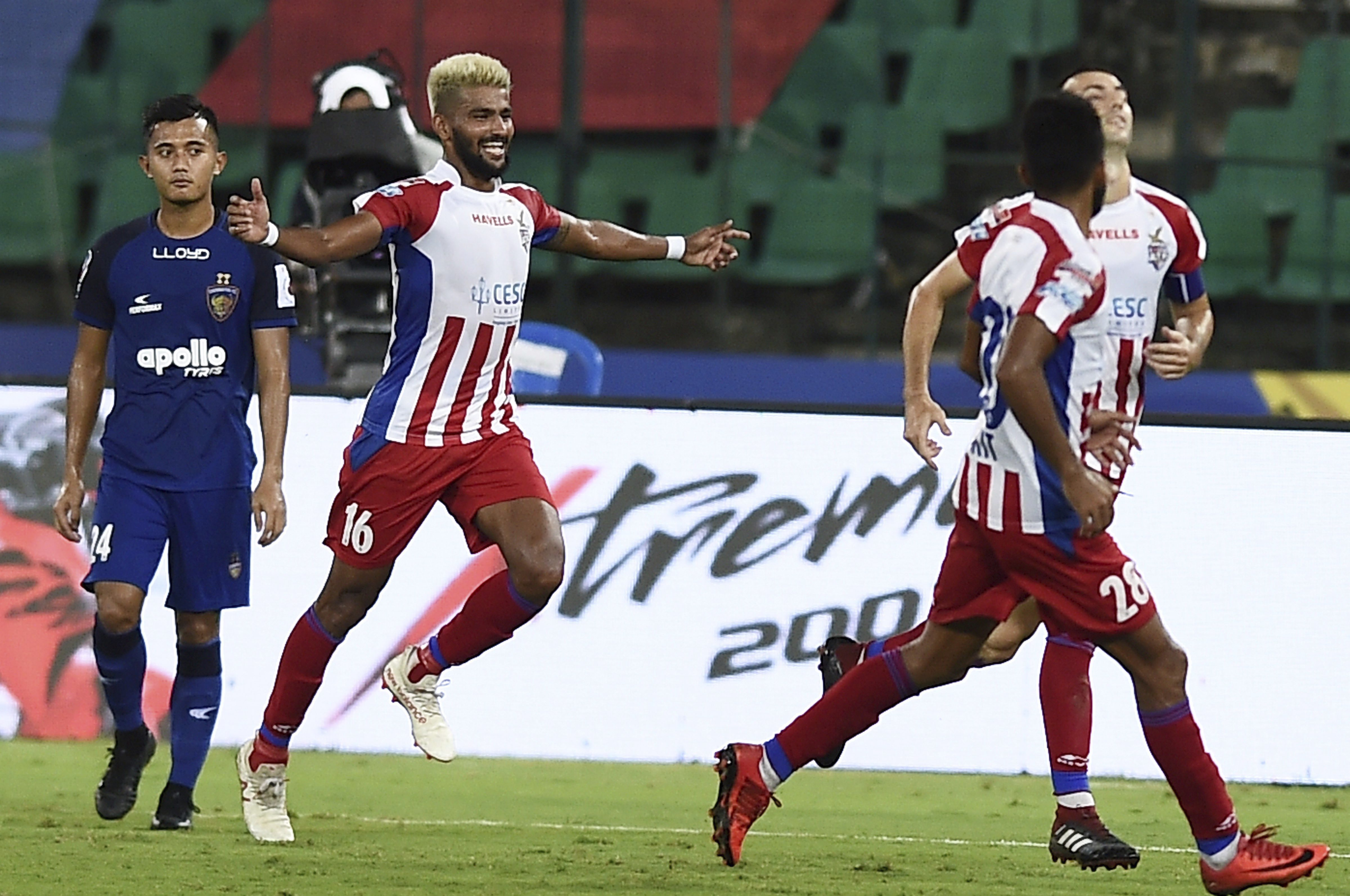 Players of Atletico De Kolkata celebrate a goal against Chennaiyin FC (Blue jersey) during their match at the 5th edition of ISL football tournament at Jawaharlal Nehru Stadium in Chennai - PTI