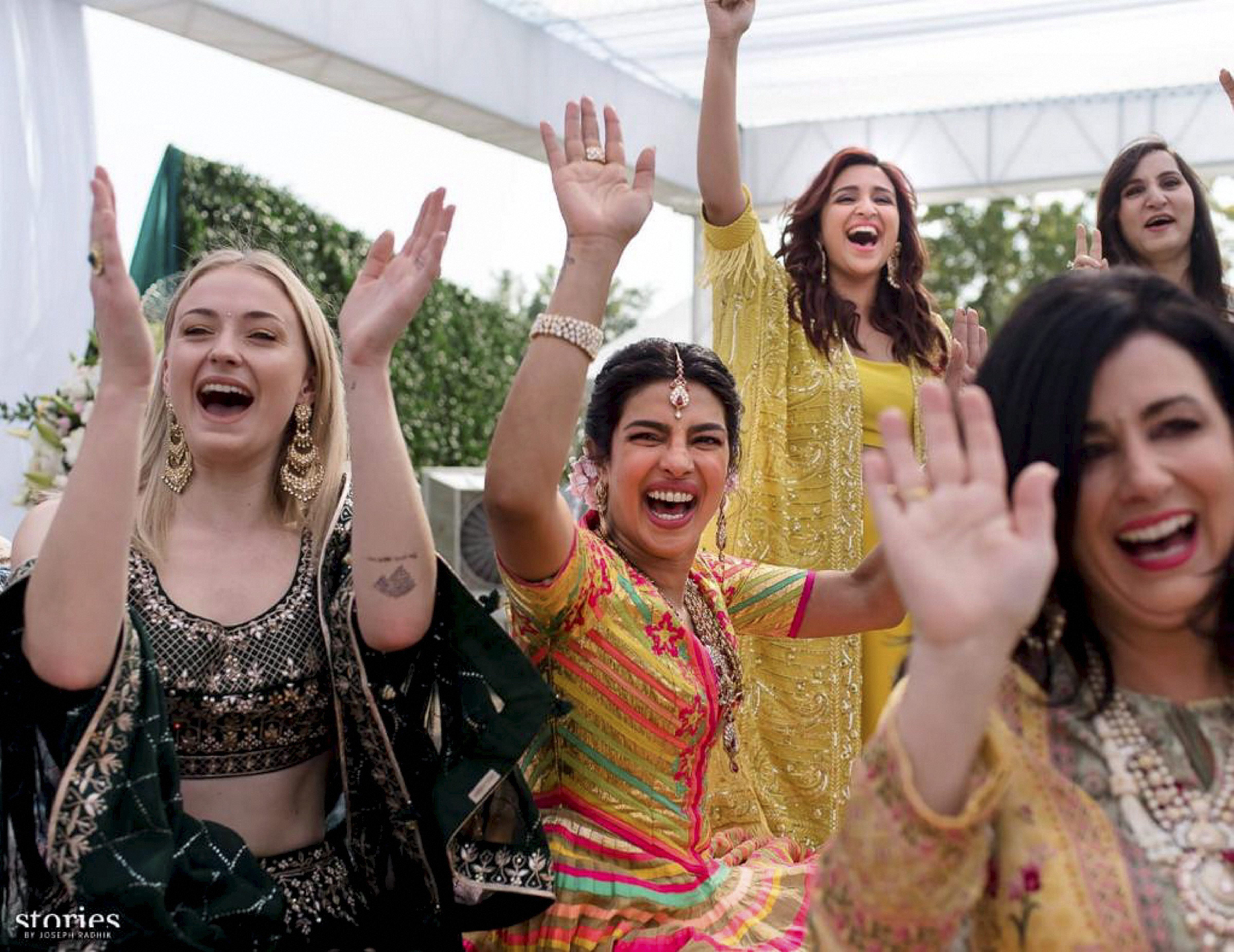 Bollywood actress Priyanka Chopra celebrates during mehendi ceremony, a day before her wedding, at Umaid Bhawan in Jodhpur - PTI