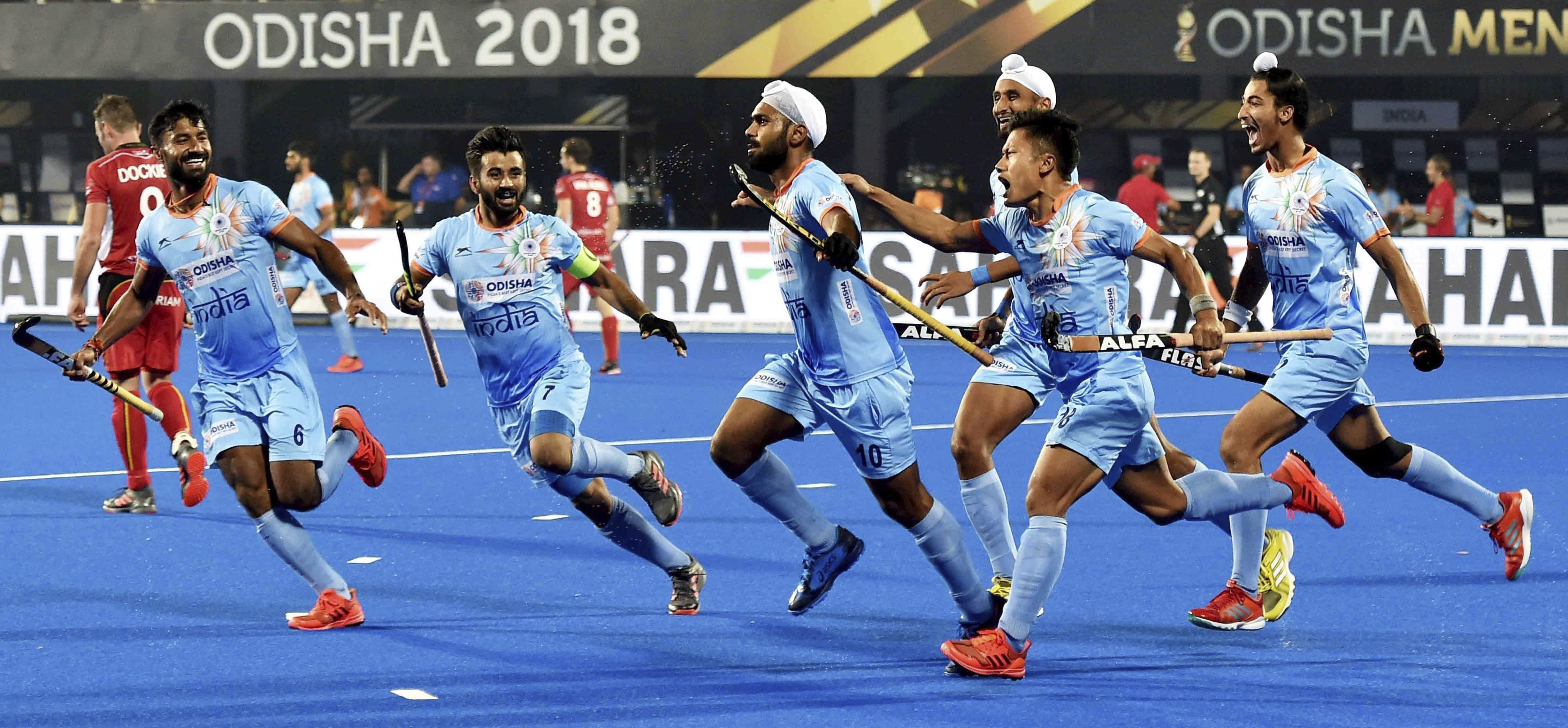 India (blue) Captain Manpreet Singh celebrates with teammates after a goal during a match against Belgium(red) for Men's Hockey World Cup 2018, in Bhubaneswar - PTI