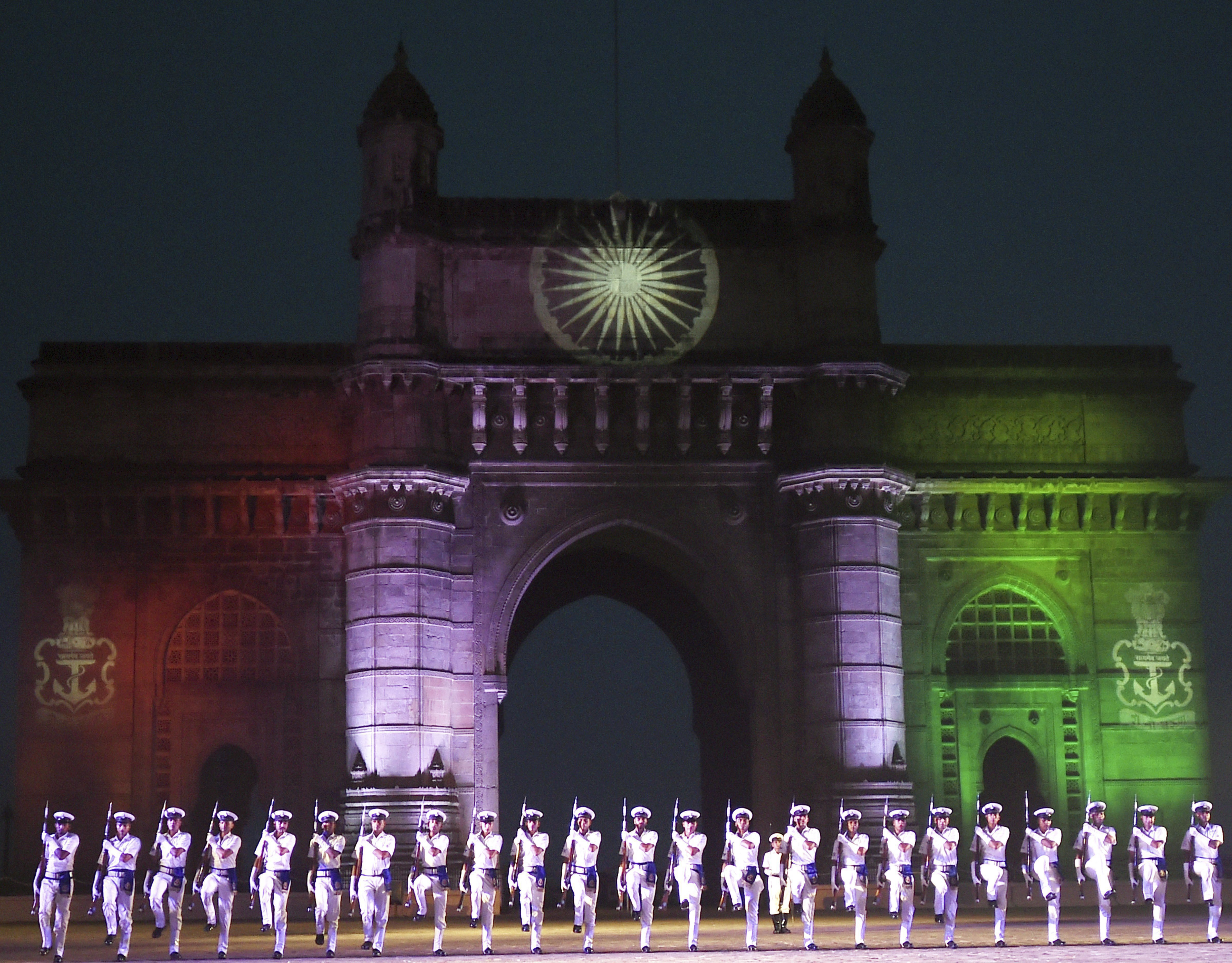 Navy personnel rehearse for the Beating Retreat and Tattoo Ceremony for the Navy Day celebration at the historical Gateway of India in Mumbai - PTI