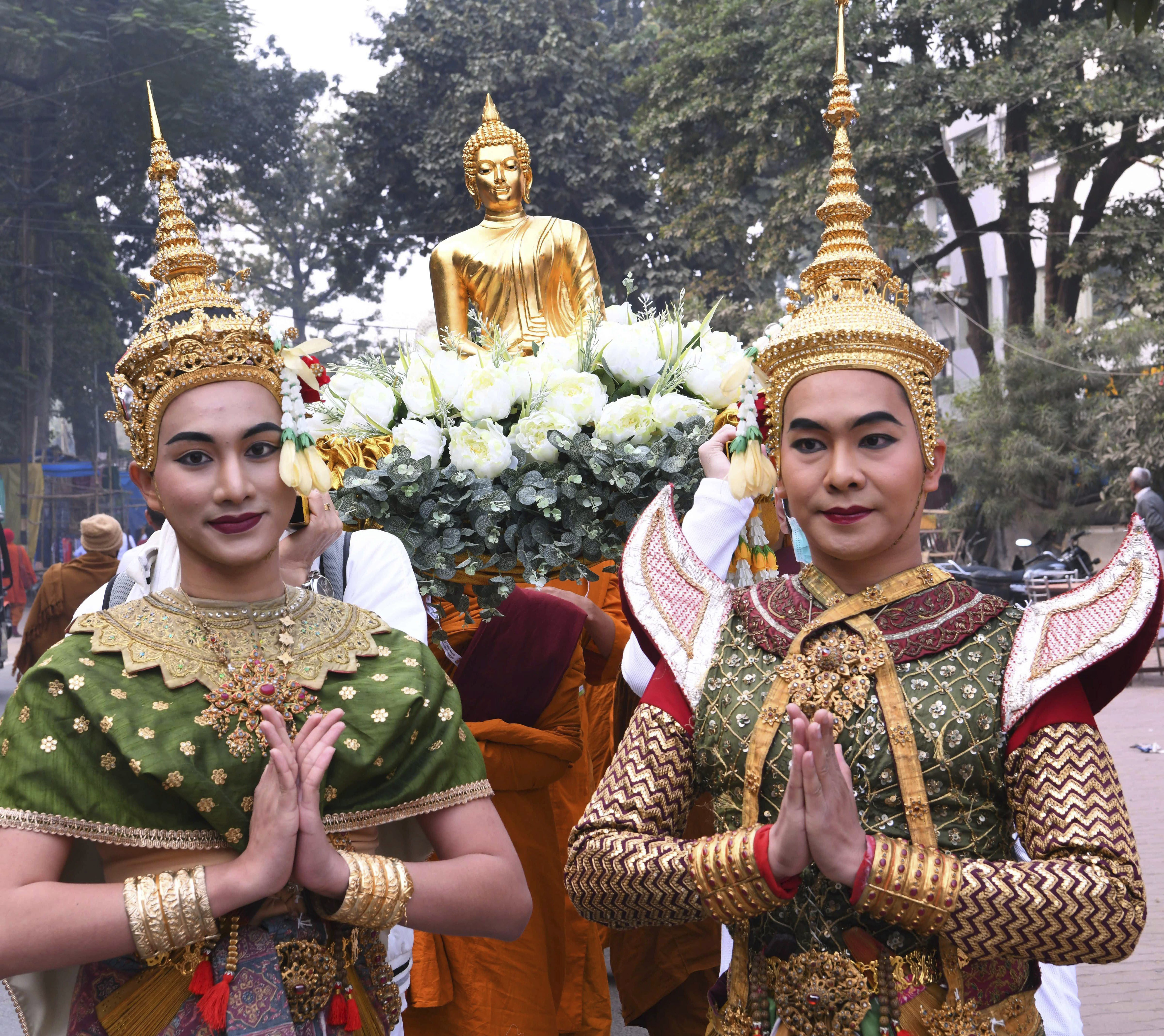 Artists from Thailand take part in a procession on the occasion of the 14th Internationl Tipitika Chanting ceromony at Mahabodhi Temple in Bodhgaya - PTI