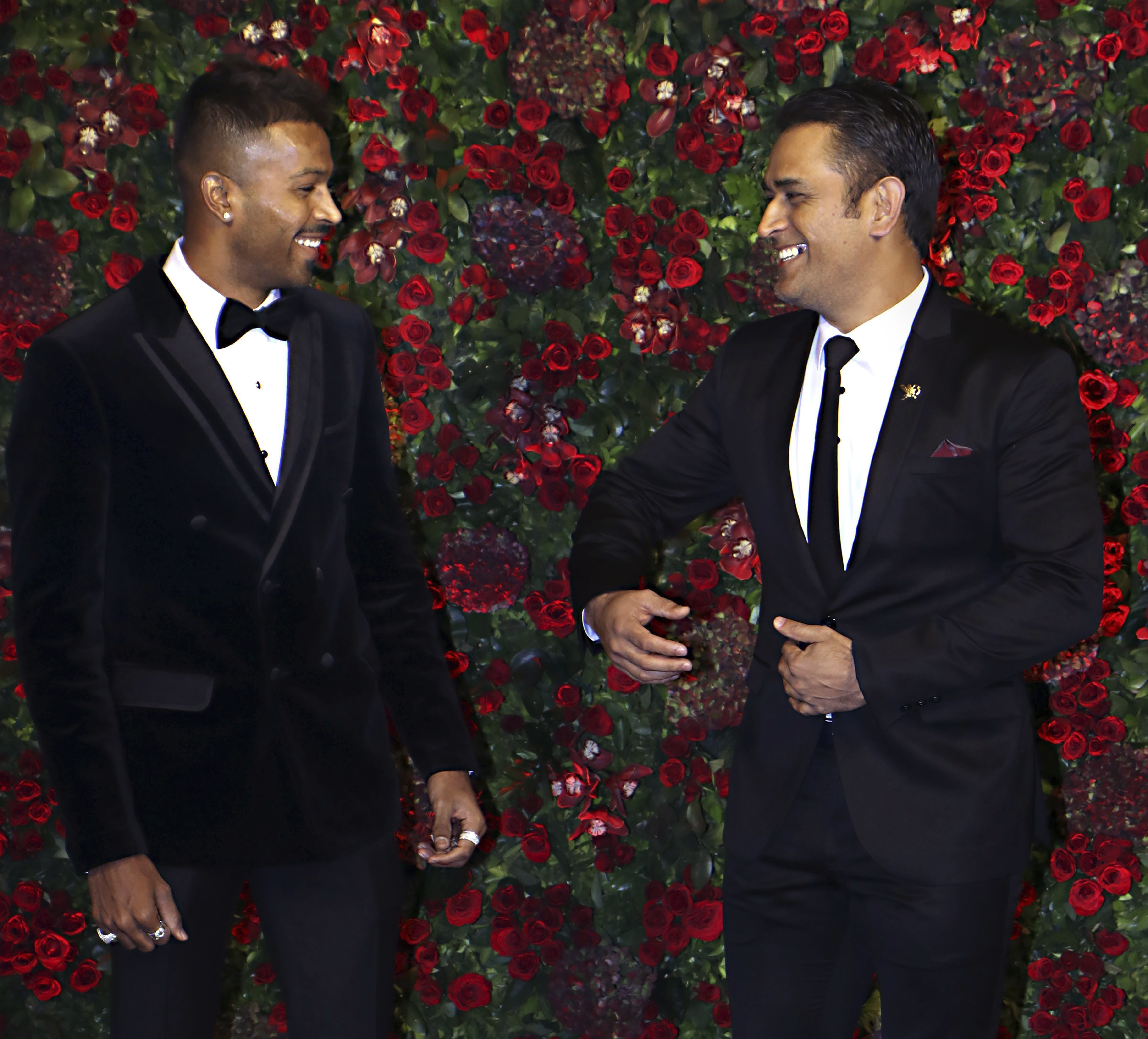 Cricketers Mahendra Singh Dhoni (R) and Hardik Pandya during the wedding reception of actors Ranveer Singh and Deepika Padukone in Mumbai - PTI