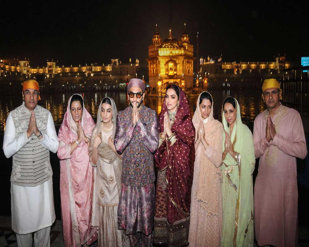 Bollywood actors Ranveer Singh and Deepika Padukone along with their family members pay obeisance at Harmandir Sahib (Golden Temple) on the occasion of their first wedding anniversary in Amritsar - PTI