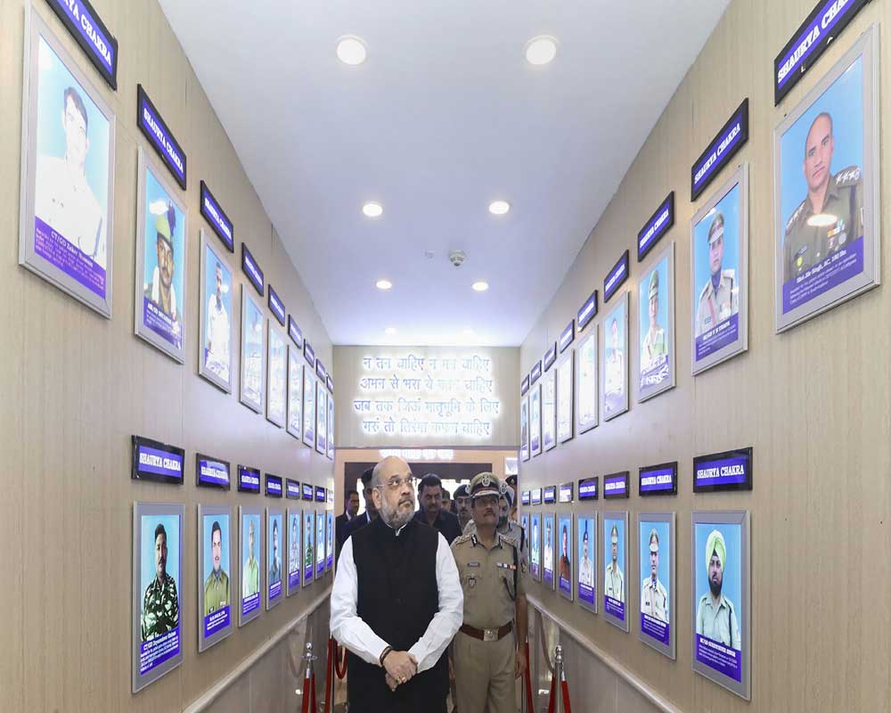 Union Home Minister Amit Shah in the gallery of gallantary award winners during his visit at the CRPF Head Quarters, in New Delhi - PTI