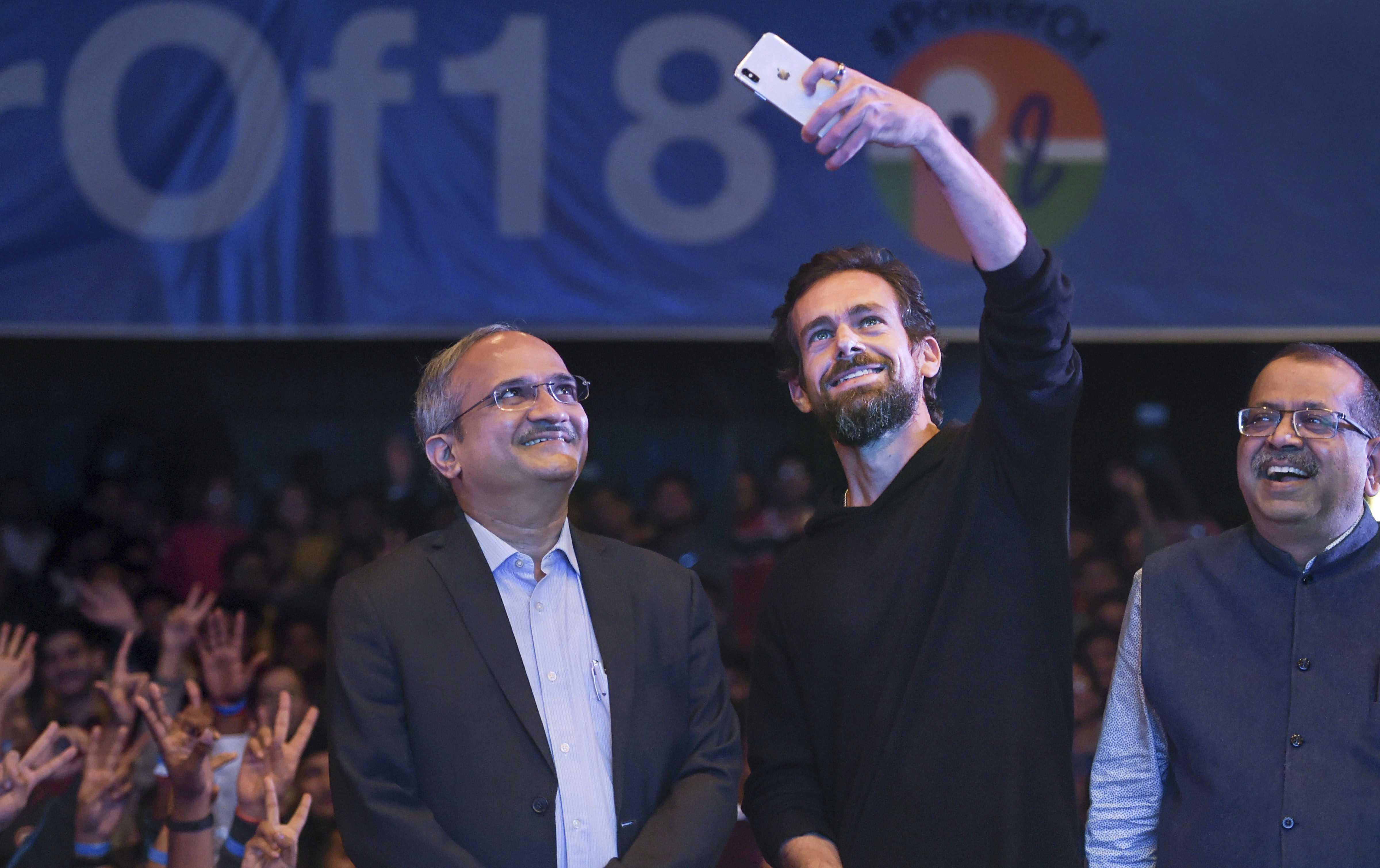 Twitter CEO and co-founder Jack Dorsey takes selfie with a faculty member of IIT Delhi, in New Delhi - PTI