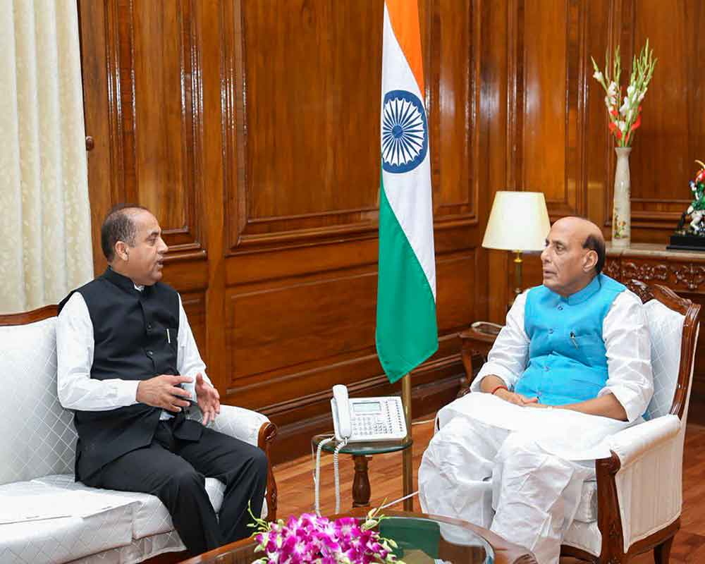 Union Defence Minister during a call-on by Himachal Pradesh Chief Minister Jairam Thakur, in New Delhi - PTI