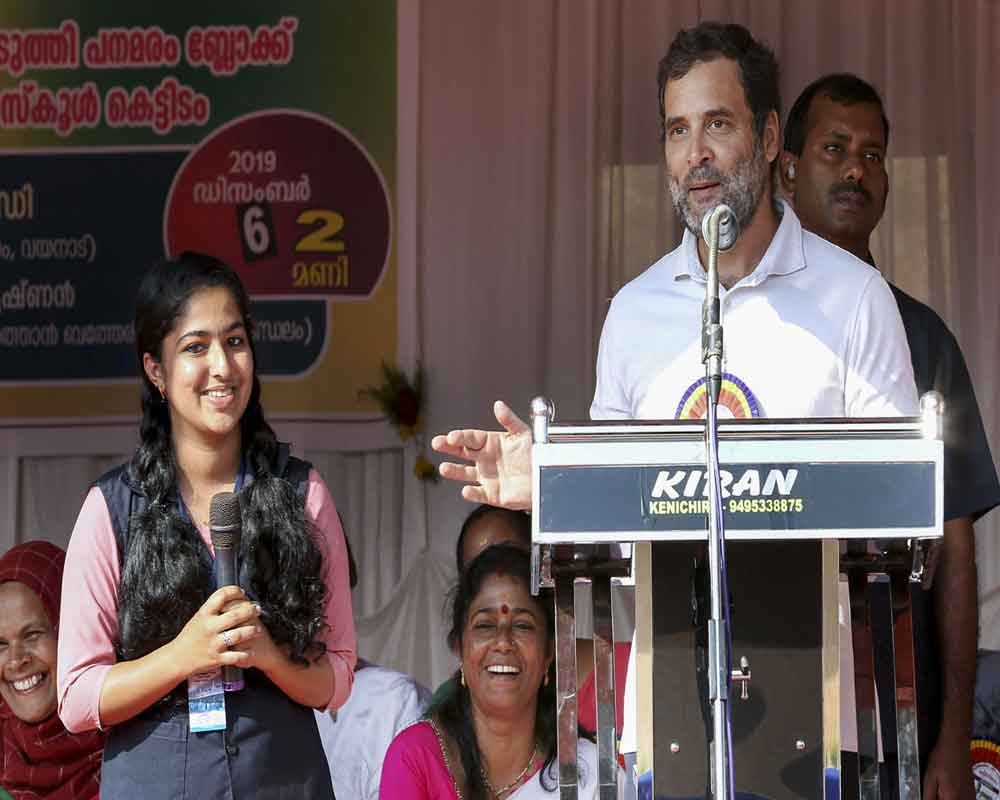 Congress leader Rahul Gandhi gives a speech as a student translates it at Vakoli Higher Secondary School, at Batheri in Wayanad - PTI