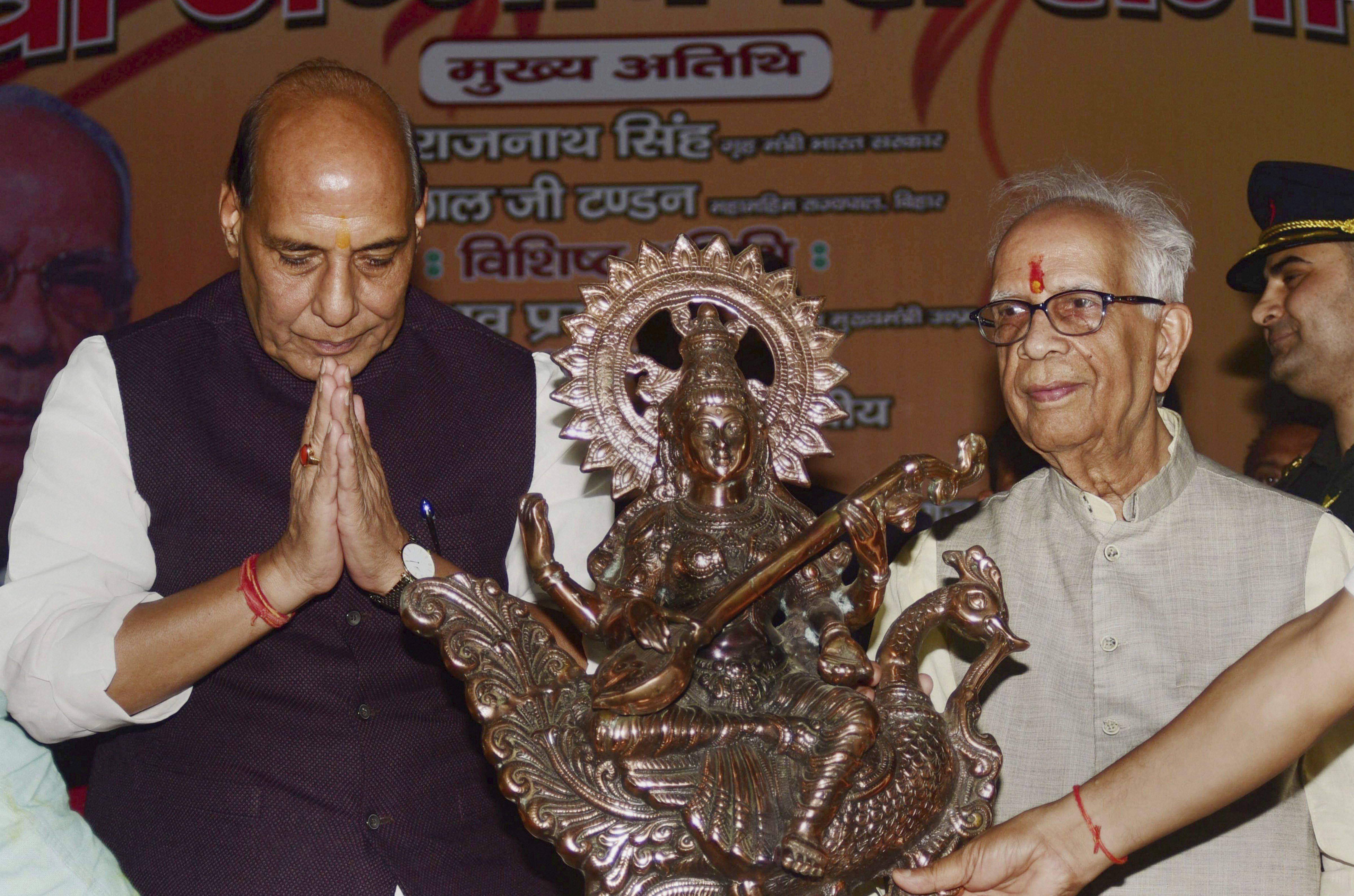 Union Home Minister Rajnath Singh greets West Bengal Governor Keshari Nath Tripathi during his birthday celebrations, in Allahabad - PTI