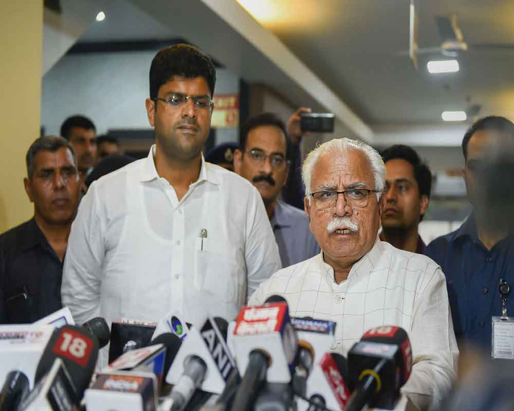 Haryana Chief Minister Manohar Lal Khattar speaks during a press conference after a meeting as Deputy Chief Minister Dushyant Chautala looks on, at Haryana Bhawan in New Delhi - PTI