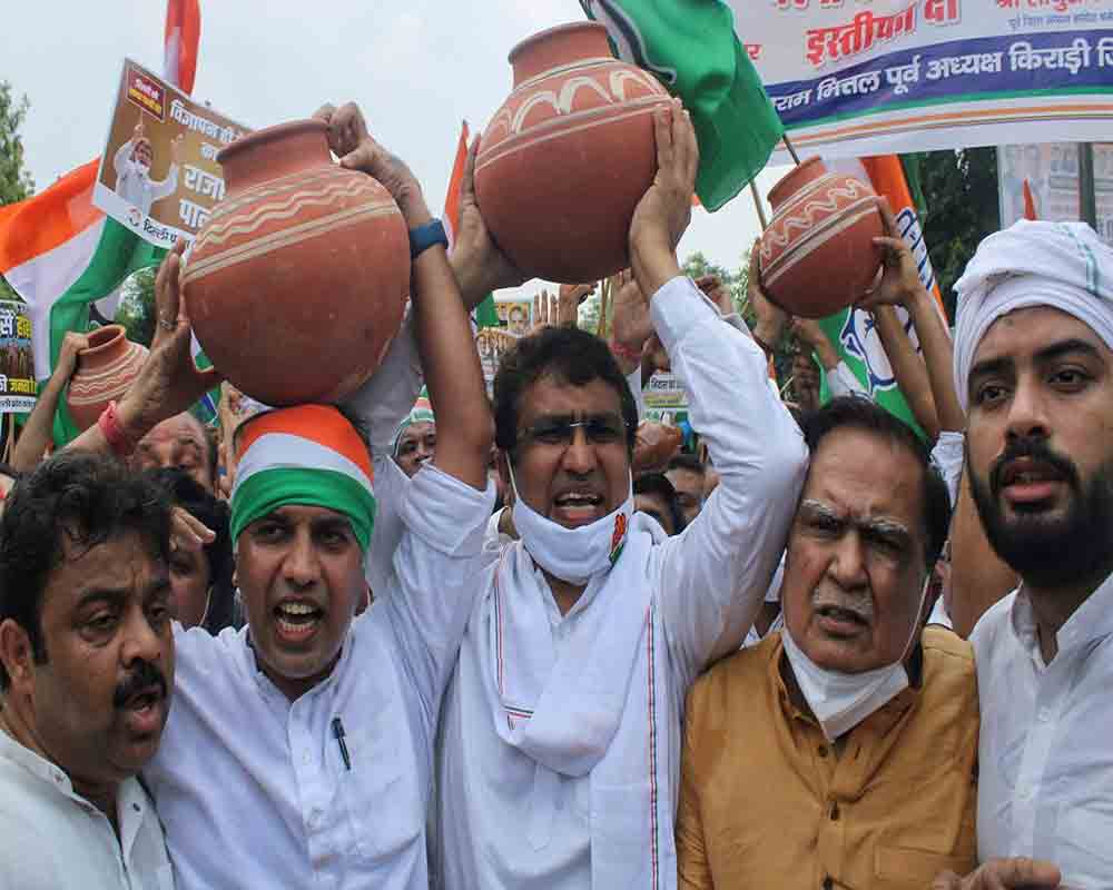 DPCC President Chaudhary Anil Kumar along with party workers protest against the water shortage in New Delhi on Friday