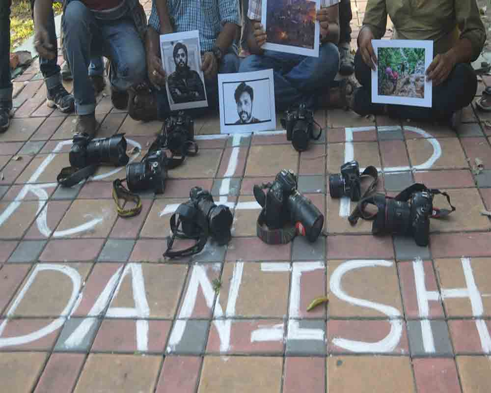 Journalists pay tribute to Danish Siddiqui, an award-winning Reuters photojournalist who was killed while covering a clash between Afghan security forces and Taliban fighters in Afghanistan, in front of the Gandhi statue in Kolkata on Friday