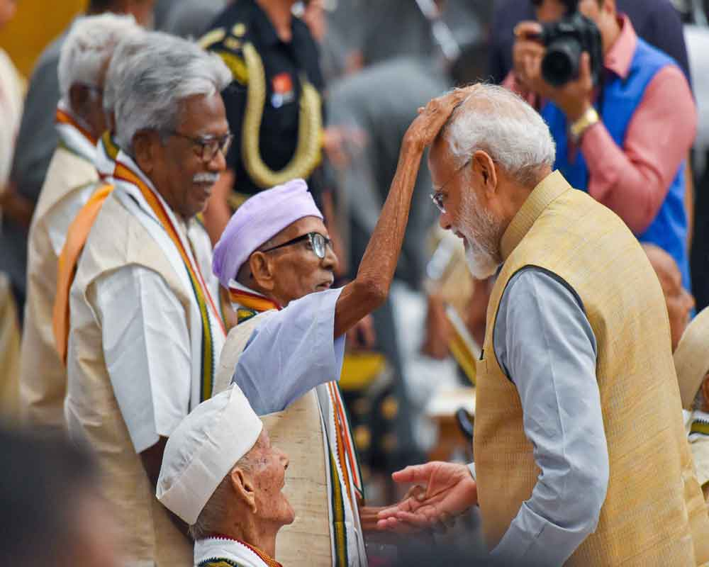 Prime Minister Narendra Modi meets freedom-fighters who were felicitated by the President on the 77th anniversary of Quit India Movement, at Rashtrapati Bhavan in New Delhi - PTI