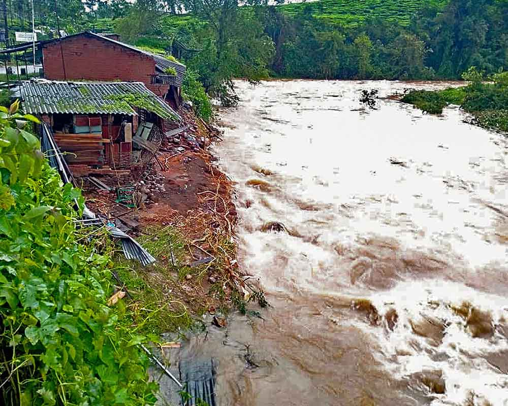 Swollen water flow following incessant monsoon rainfall causing flood and lanslide, near Meppadi in Wayanad - PTI