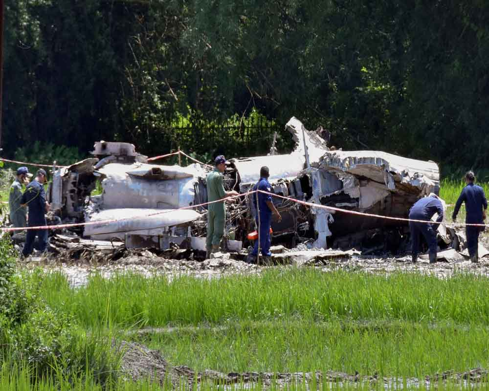 A team of the Indian Air Force officials inspect the site where Su-30 crashed yesterday, at Sonitpur on the outskirts of Tezpur - PTI