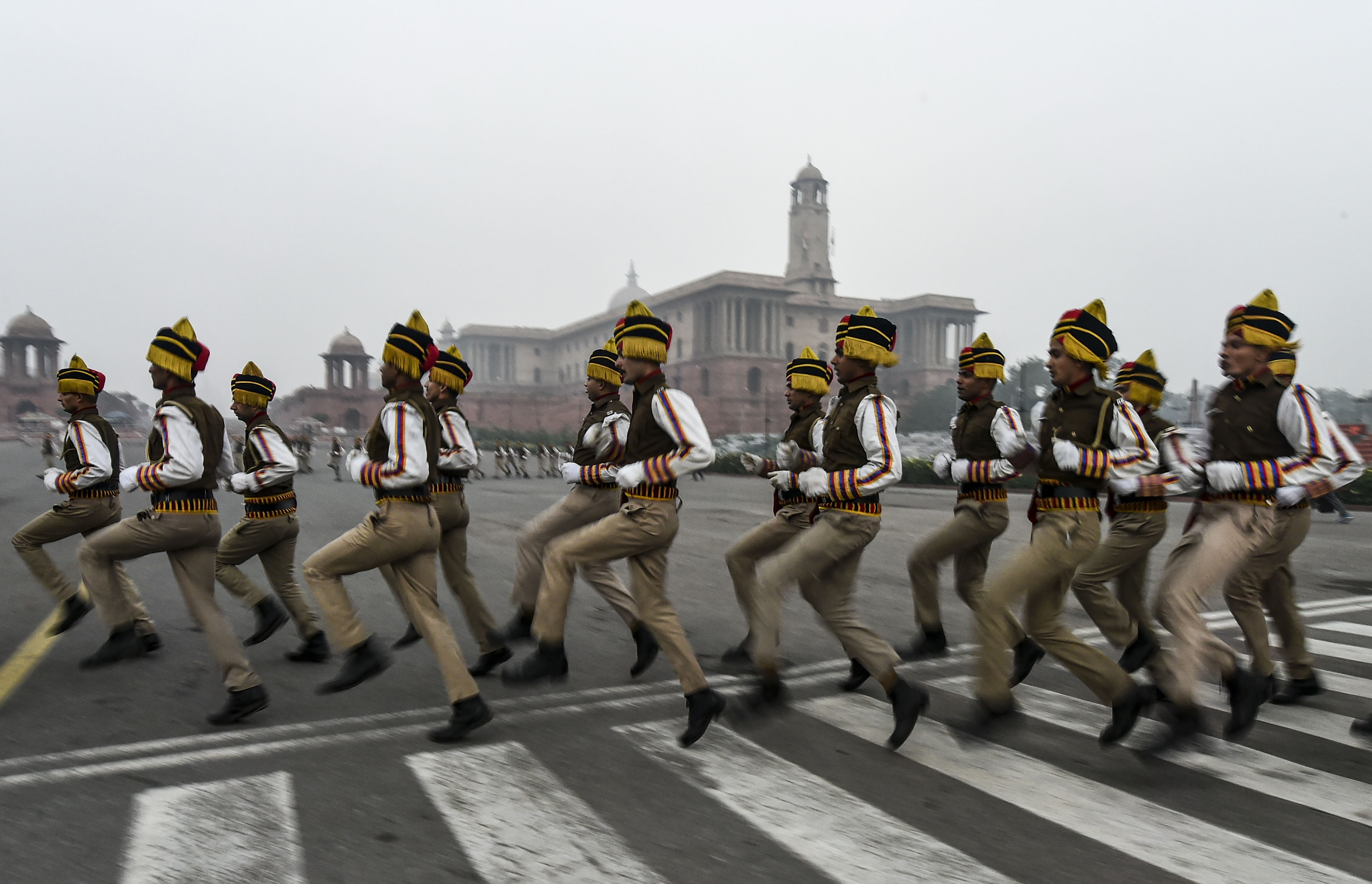 Delhi Police personnel during the rehearsal for the upcoming Republic Day parade, on a cold, winter morning at Rajpath in New Delhi - PTI