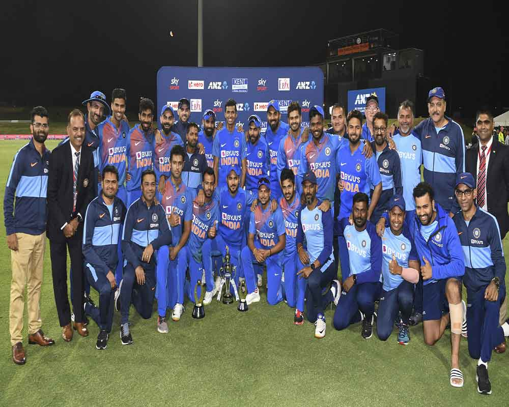 India players pose for a group photo as they celebrate a 5-0 series win during the Twenty/20 cricket international between India and New Zealand at Bay Oval in Mt Maunganui, New Zealand - PTI