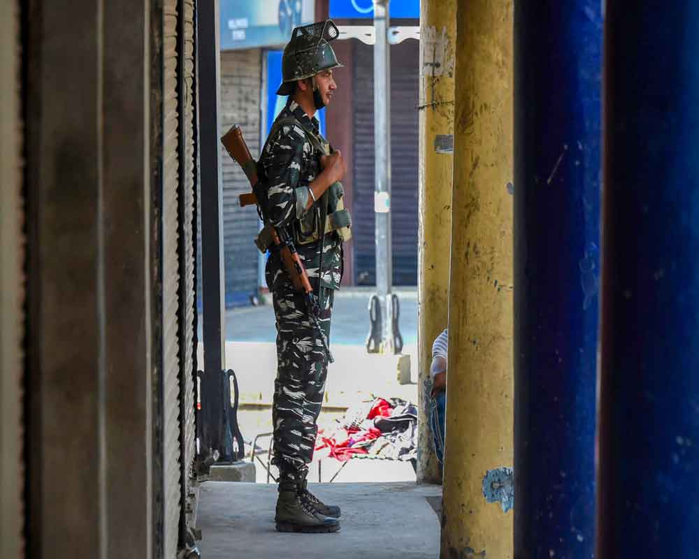 A security personnel stands guard during shutdown in Srinagar - PTI
