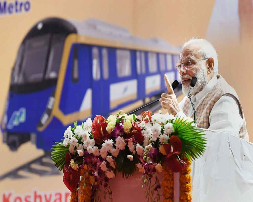 Prime Minister Narendra Modi addresses at the foundation stone laying ceremony of the various Metro Projects, in Mumbai - PTI