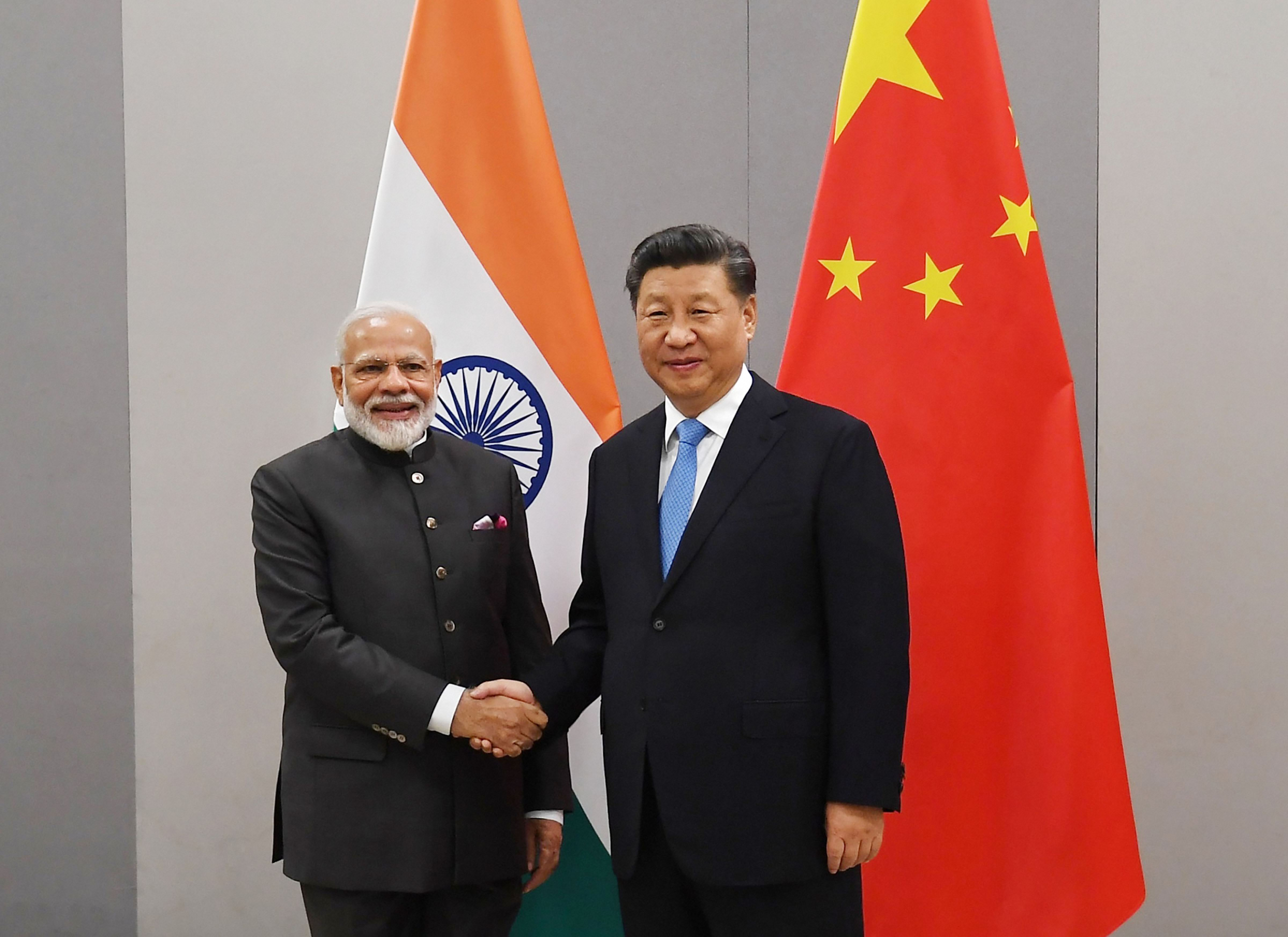 Prime Minister Narendra Modi shakes hands with Chinese President Xi Jinping during a meeting on the sidelines of BRICS Summit - PTI