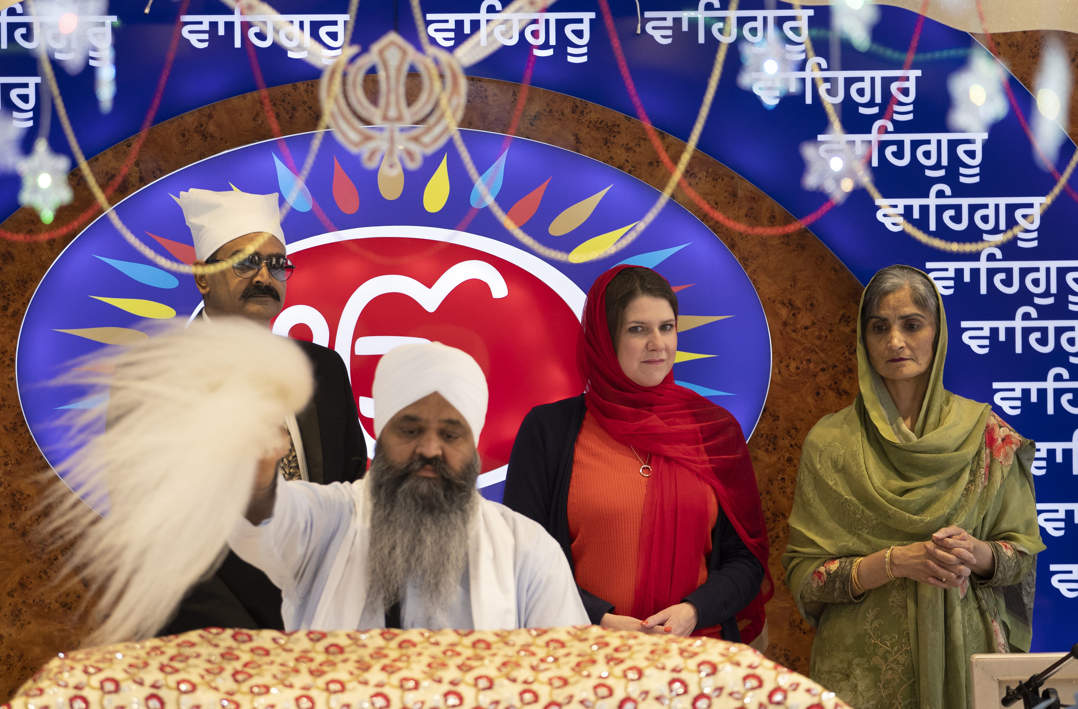 Britain's opposition Liberal Democrats party leader Jo Swinson, 2nd right, during a ceremony as she is welcomed during a visit to the Gurdwara Singh Sabha Temple for an election campaign stop in Glasgow- AP